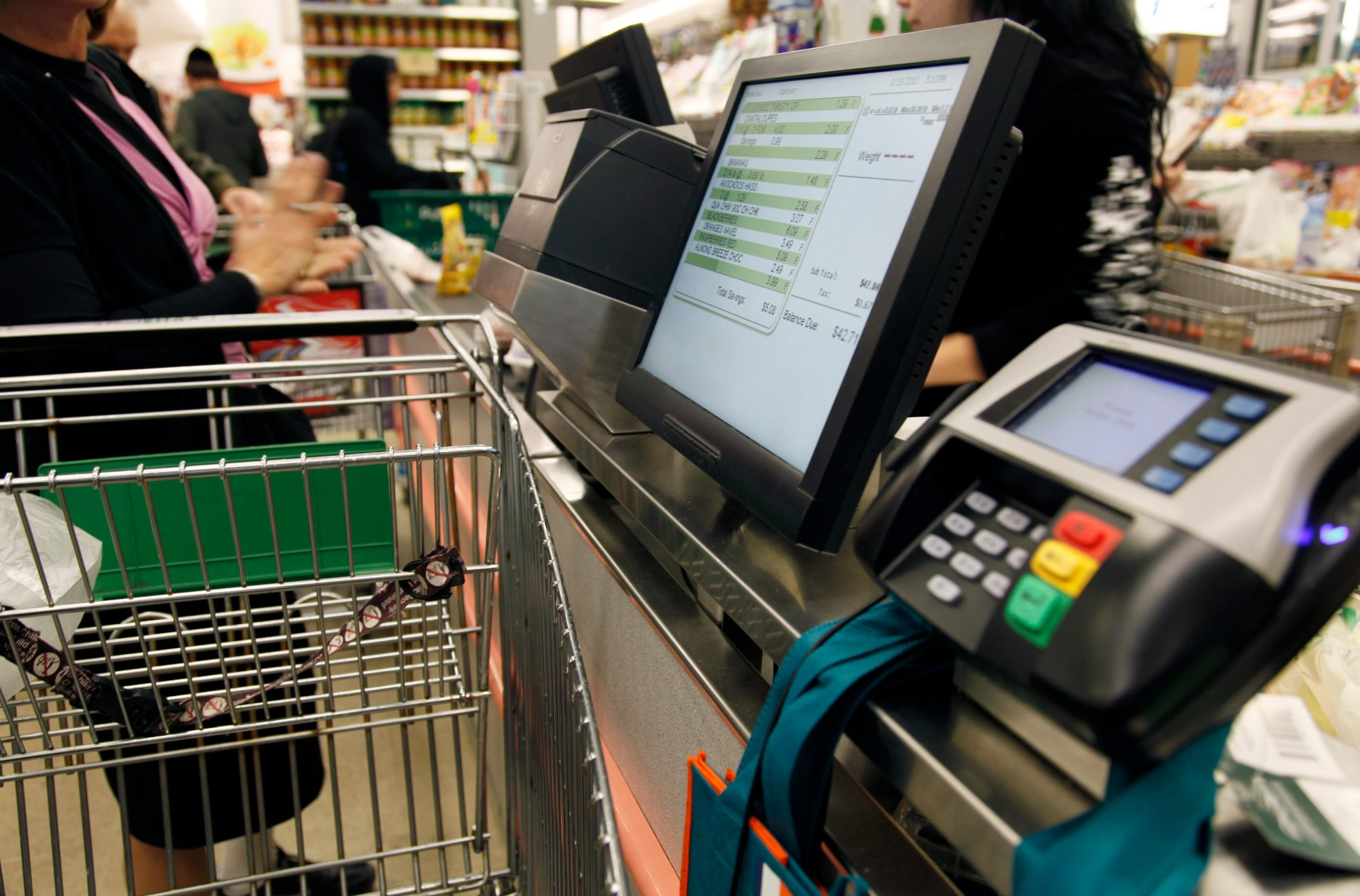 A person at the cash register of a supermarket
