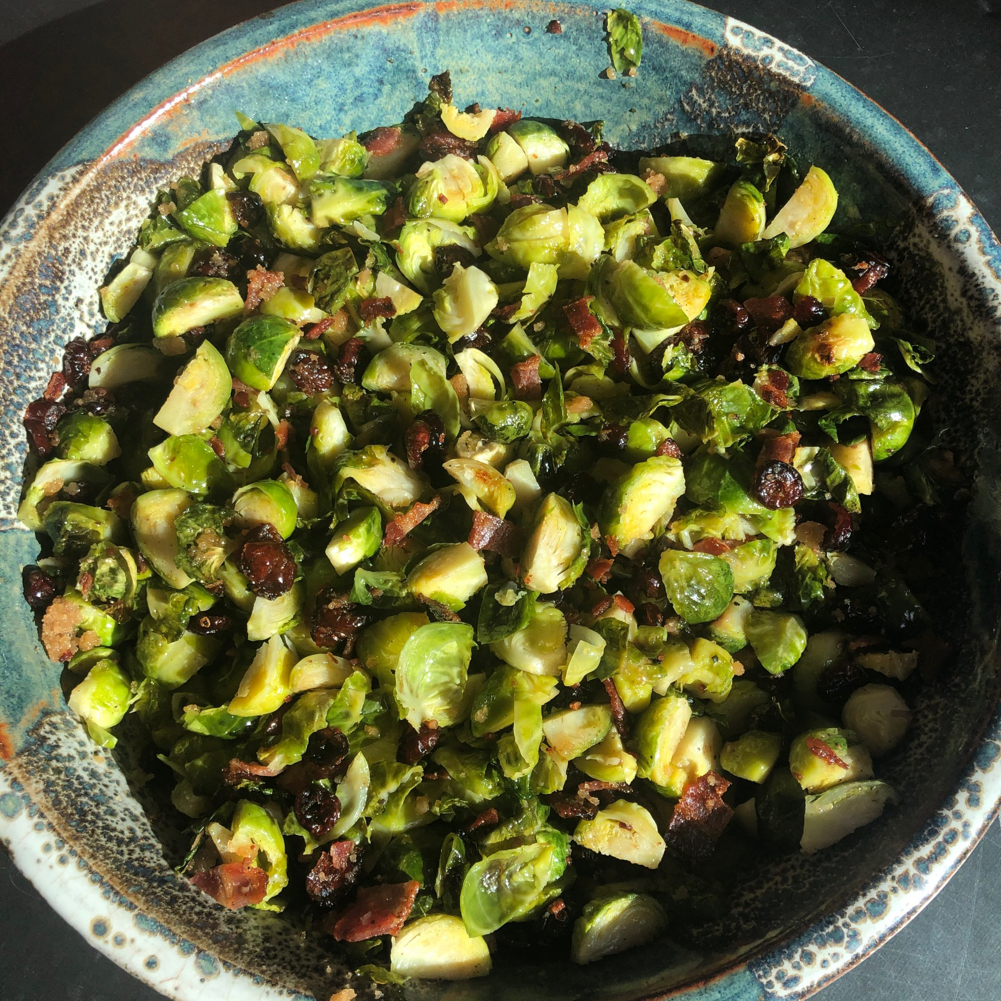 Roasted Brussels Sprouts with Cranberries in a turquoise serving bowl