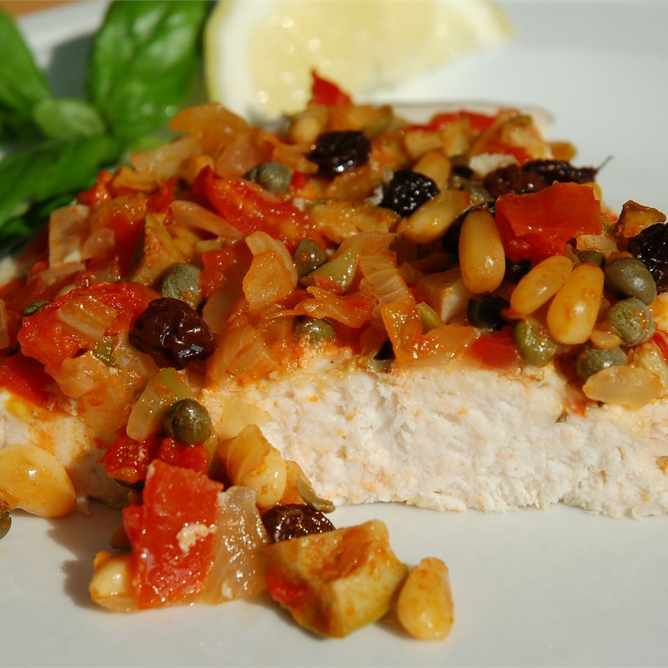 Swordfish in red sauce with pine nuts, olives, caper