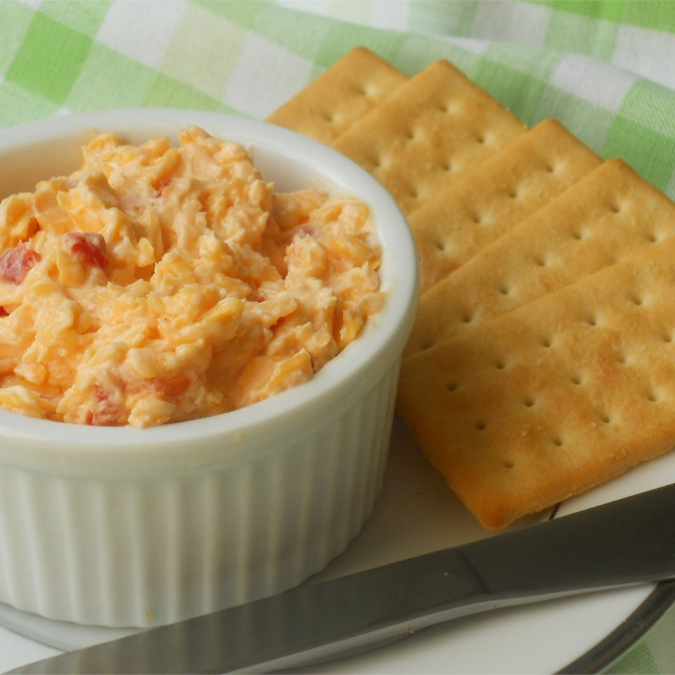 Simultaneously creamy, tangy, and sweet, pimento cheese is a southern staple. Serve a batch of this spreadable dip with crackers, cut veggies, or in little finger sandwiches made with (what else?) white bread without the crusts.