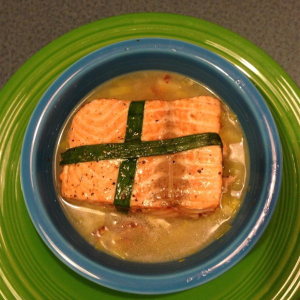 "These oven-baked salmon filets are decoratively wrapped in green onions and served over a light and tasty bacon, potato, and leek chowder. ""This really produces a fantastic piece of salmon, and when paired with a simple potato and leek chowder, would make a terrific Valentine's dinner idea,"" says Chef John."