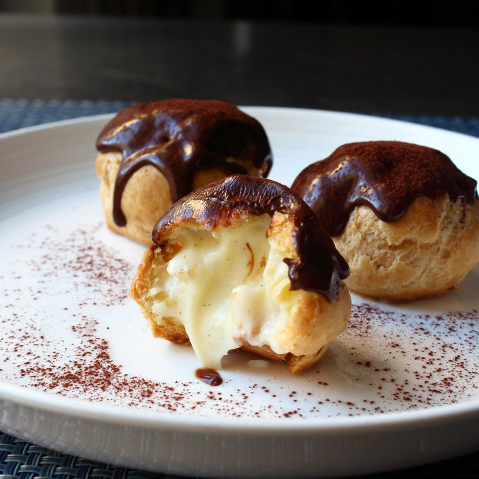 ganache-topped profiteroles filled with creme patisserie