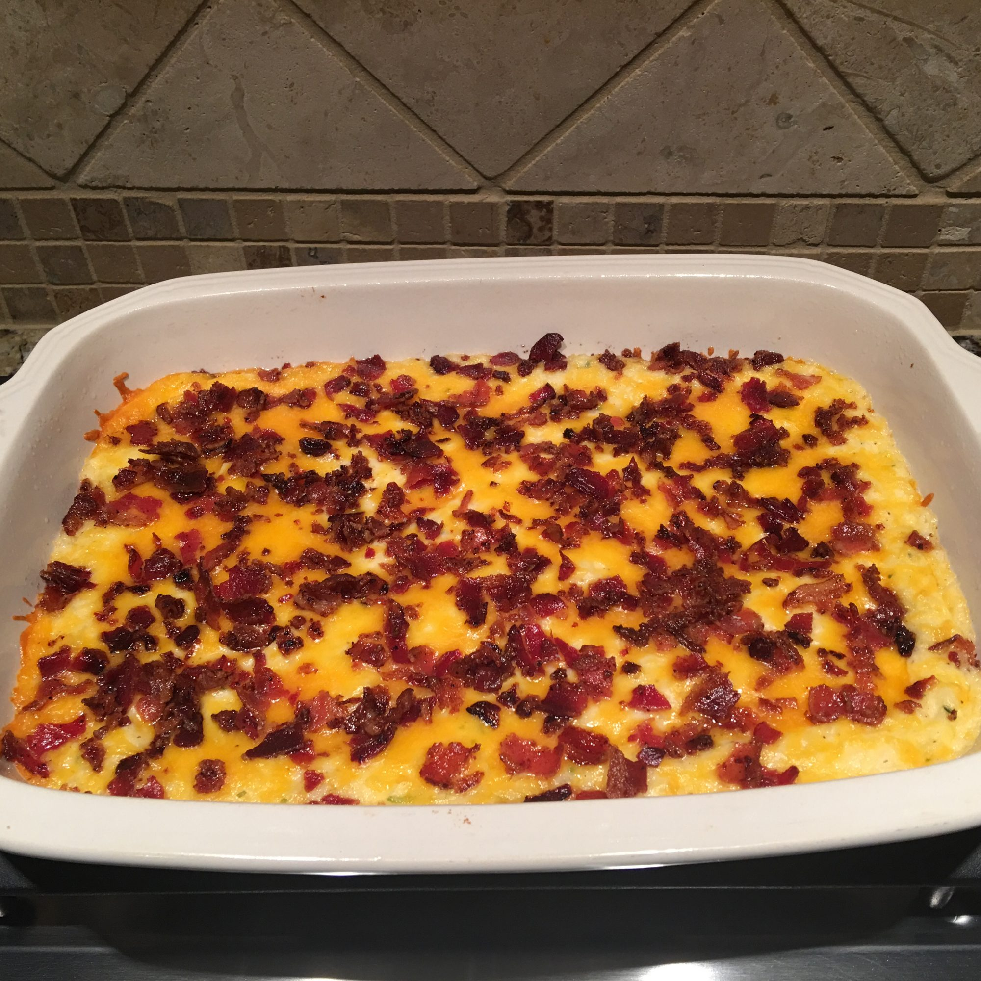Twice Baked Potato Casserole With Bacon in a white casserole dish