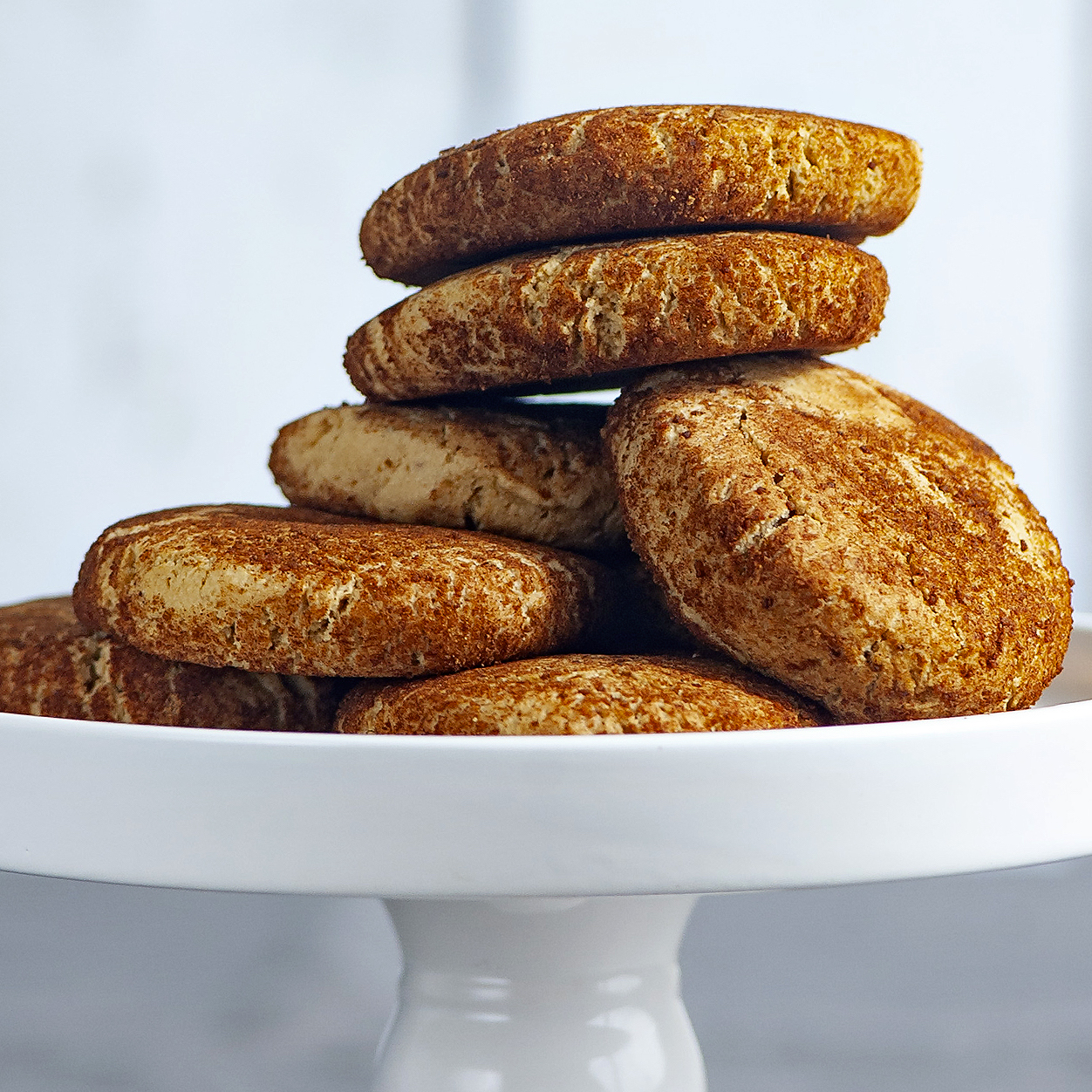 stack of snickerdoodles on a white cake stand