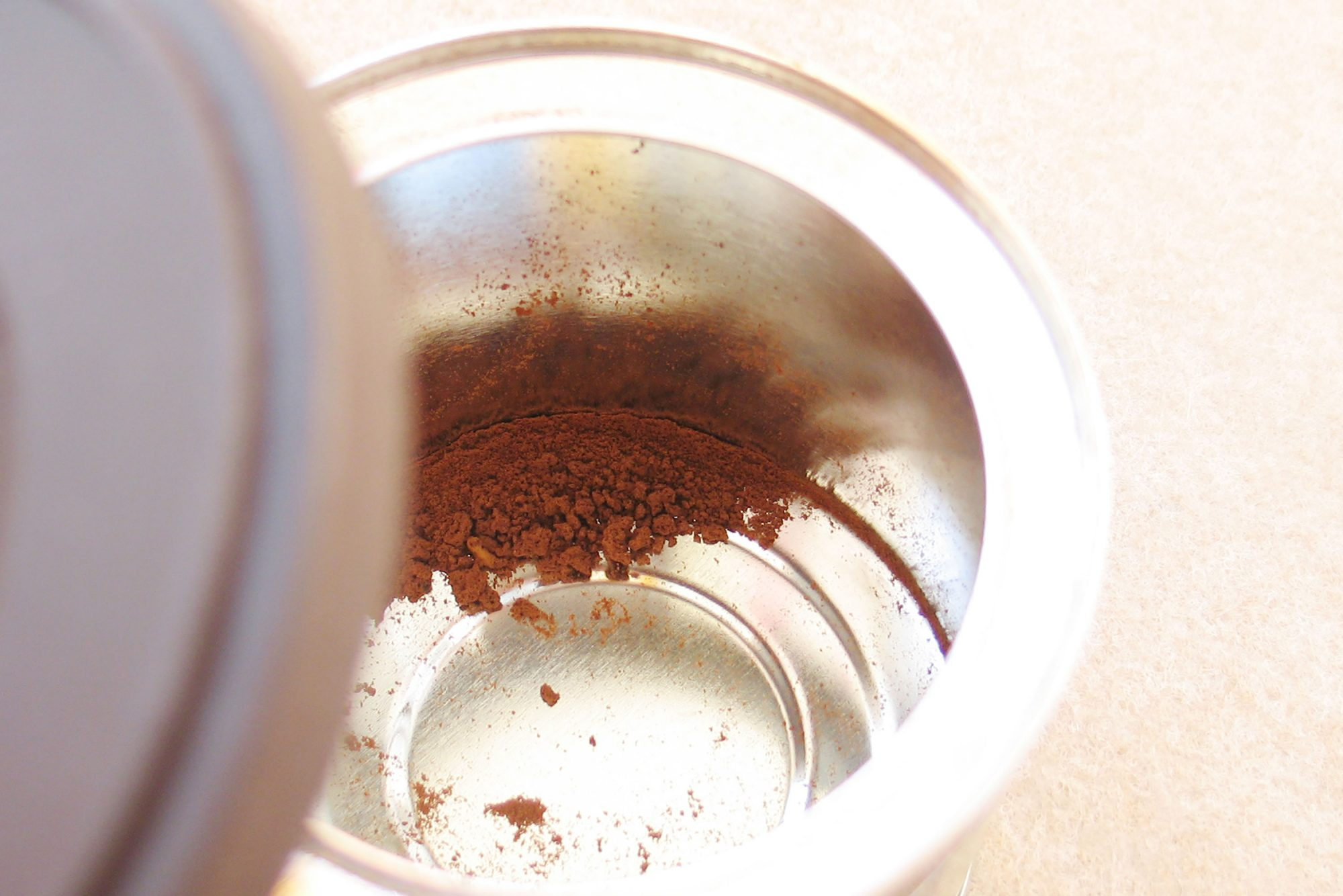 Empty coffee tin with grounds