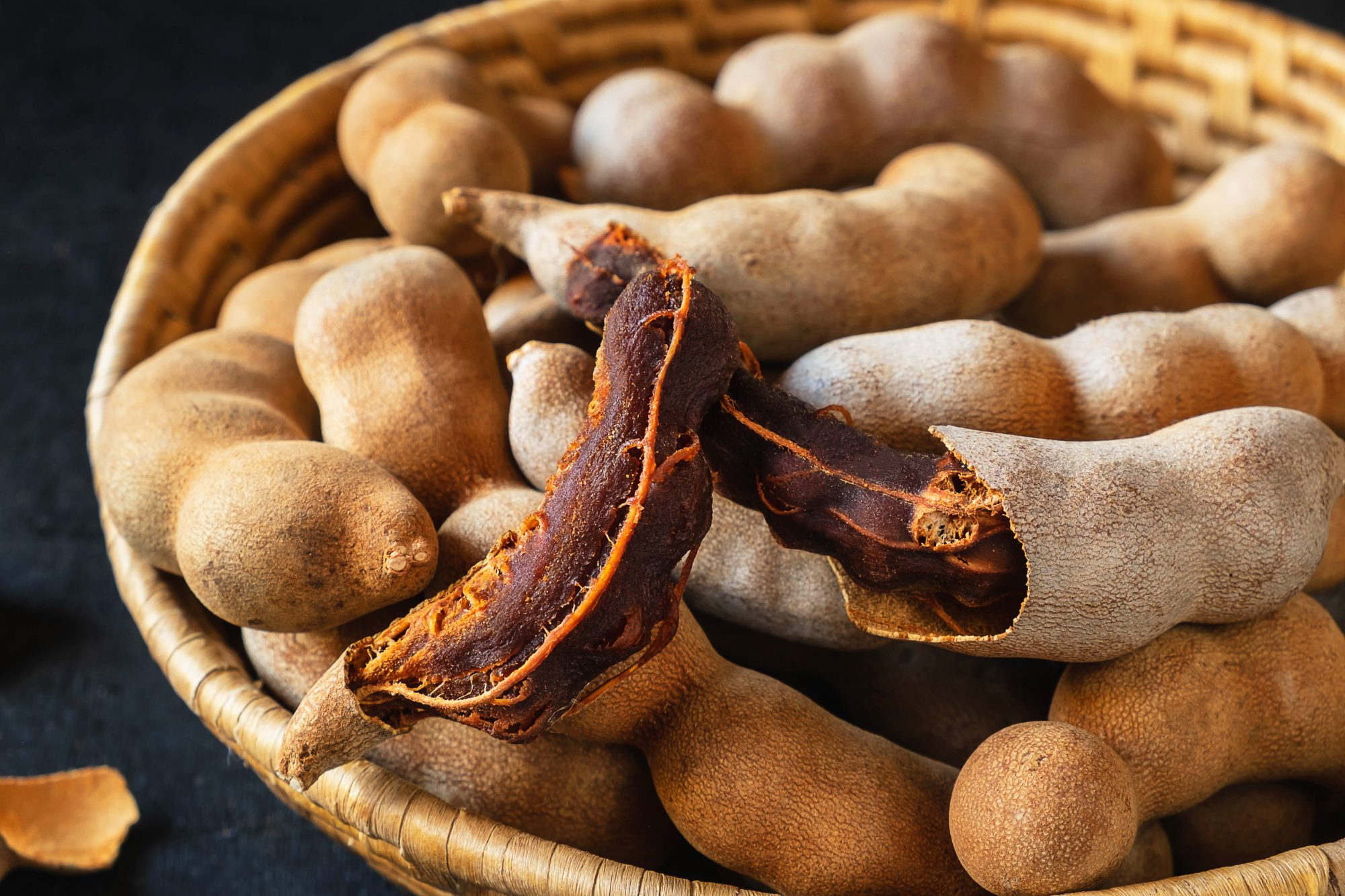Tamarind in a wooden basket on the table