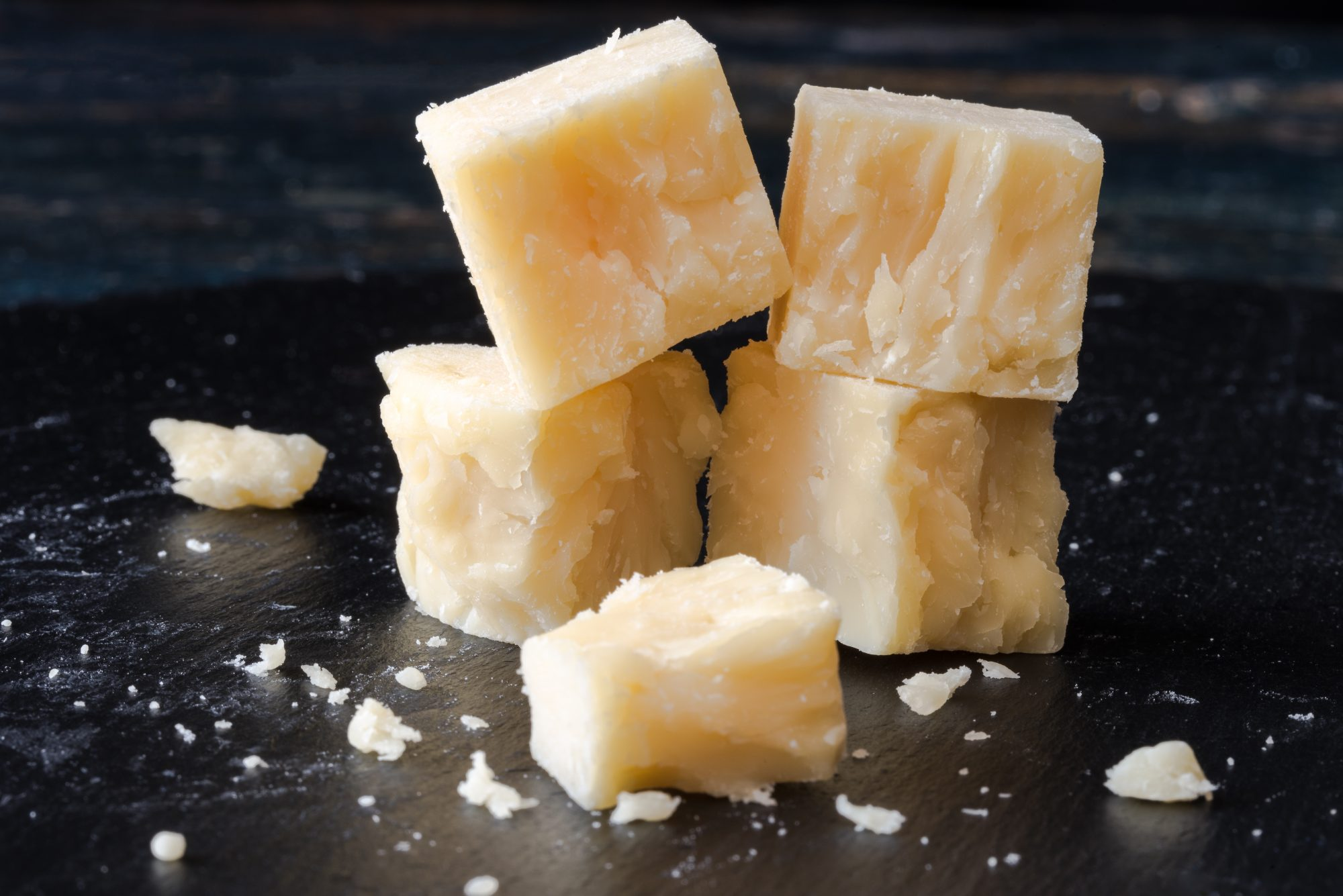 Close-Up Of White Cheddar Cheese On Table