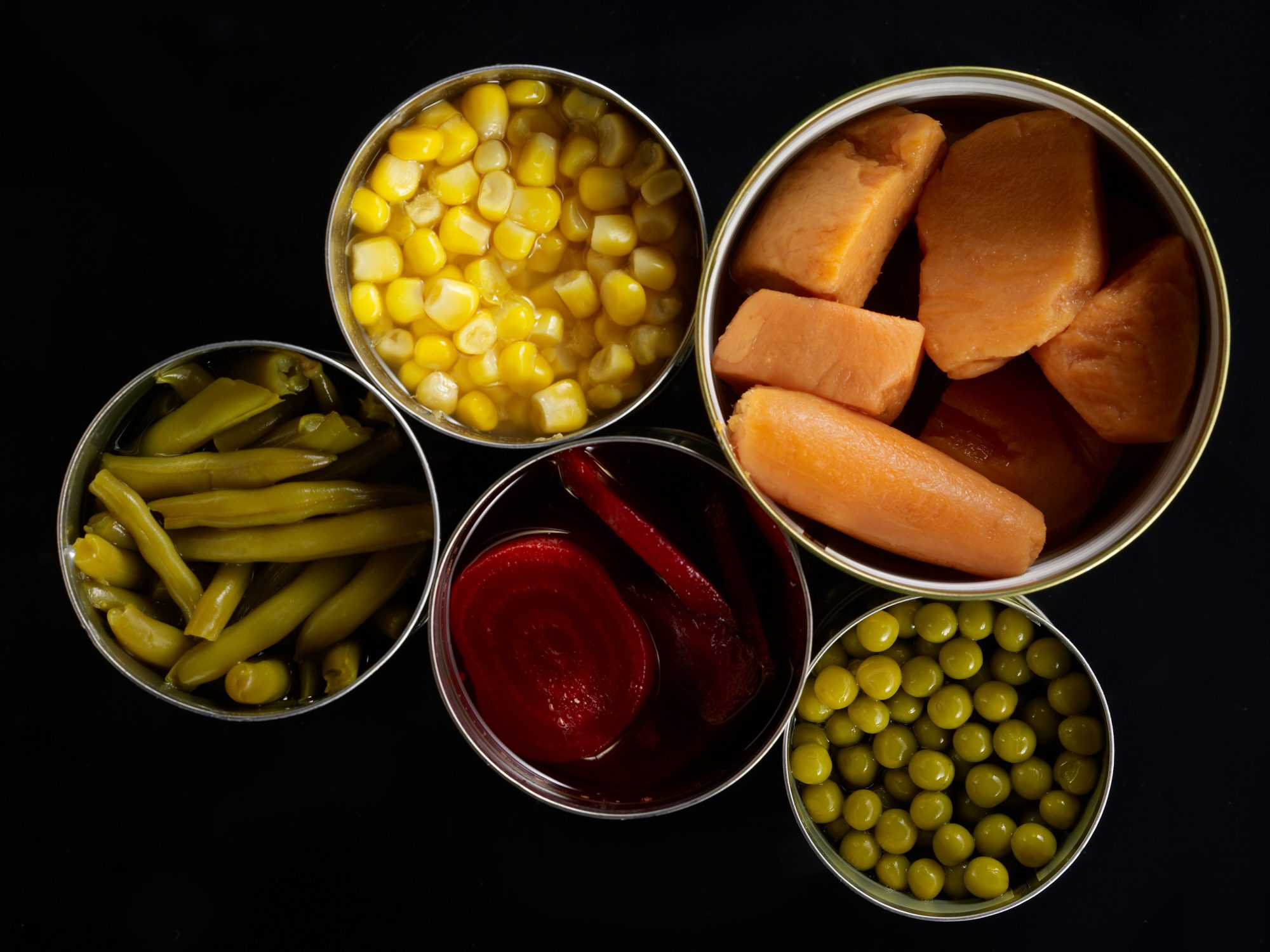 A variety of produce-sweet potato, beans, peas, corn, beets
