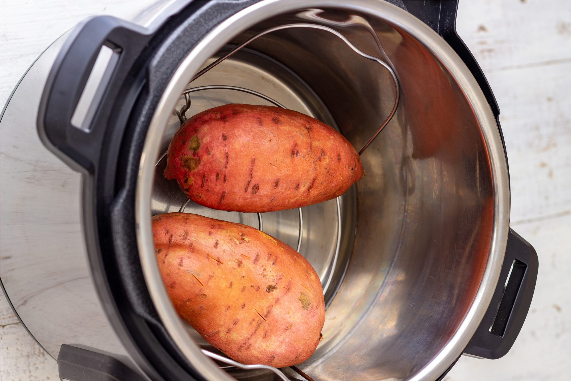 Instant Pot with Sweet Potatoes inside