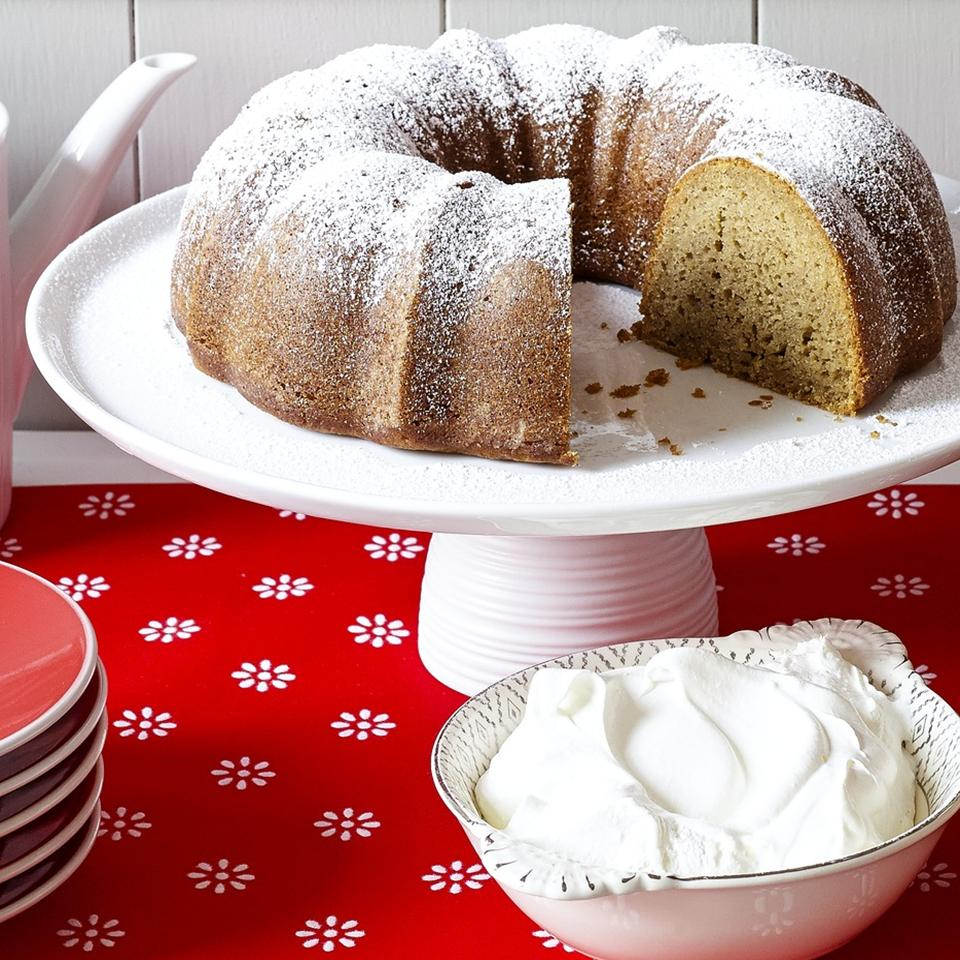 Boscobel Beach Ginger Cake on a cake stand with whipped cream