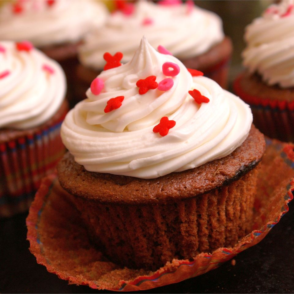 chocolate cupcakes with vanilla frosting and valentine's day sprinkles