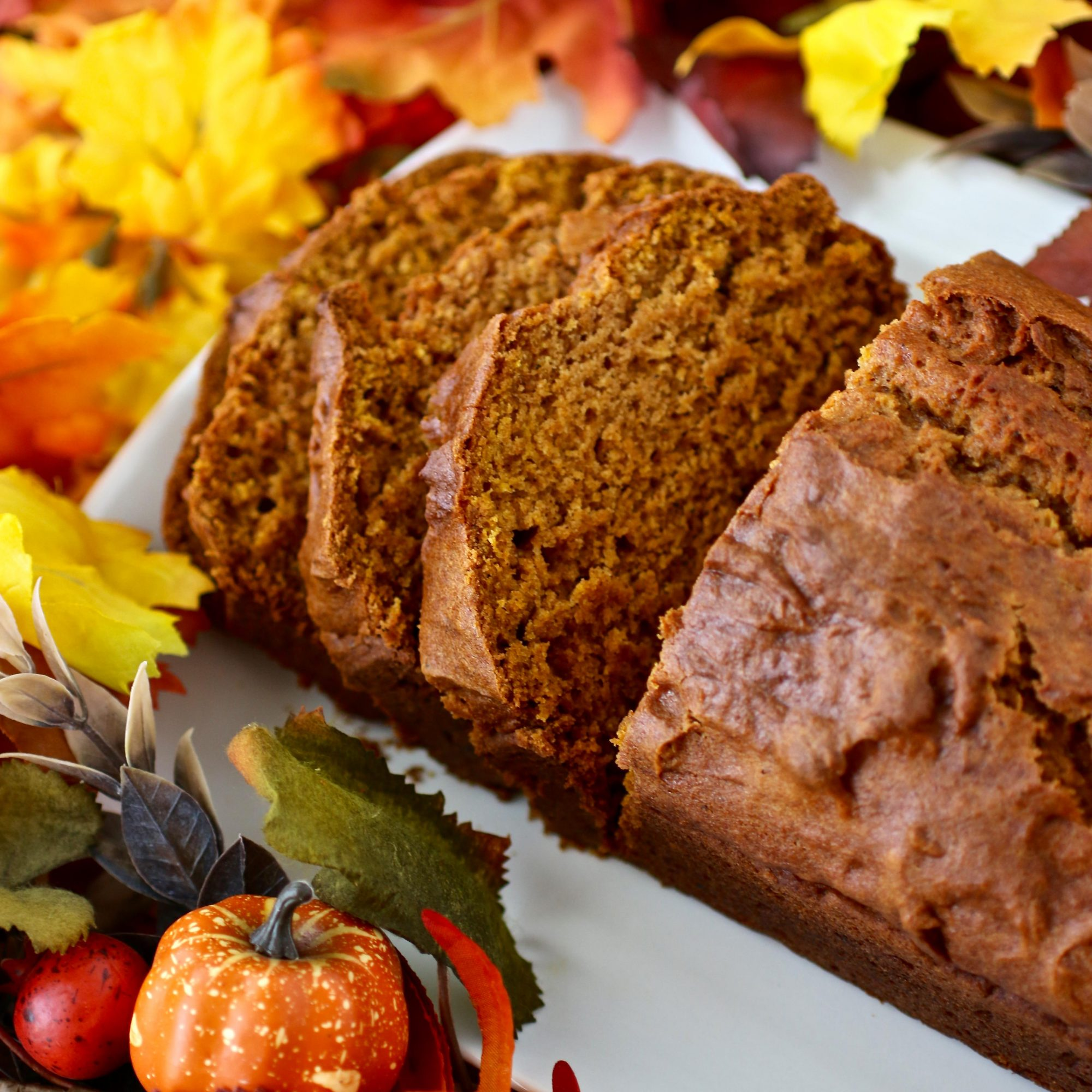 Downeast Maine Pumpkin Bread on a white dish with fall decor