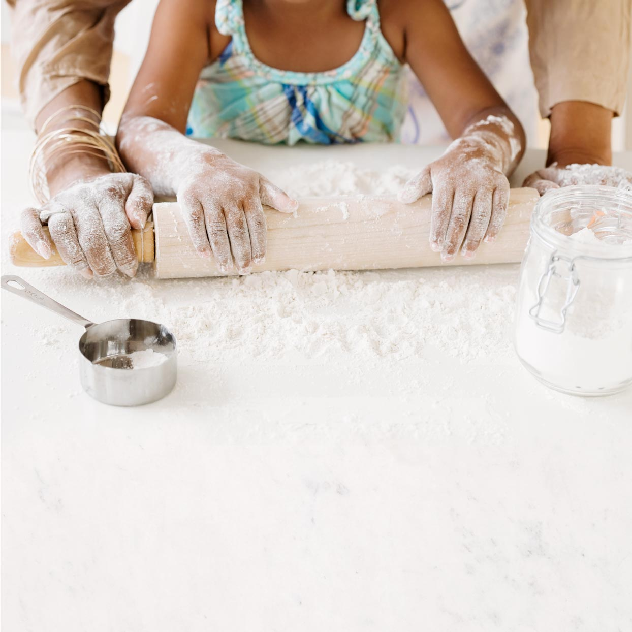kids rolling out flour