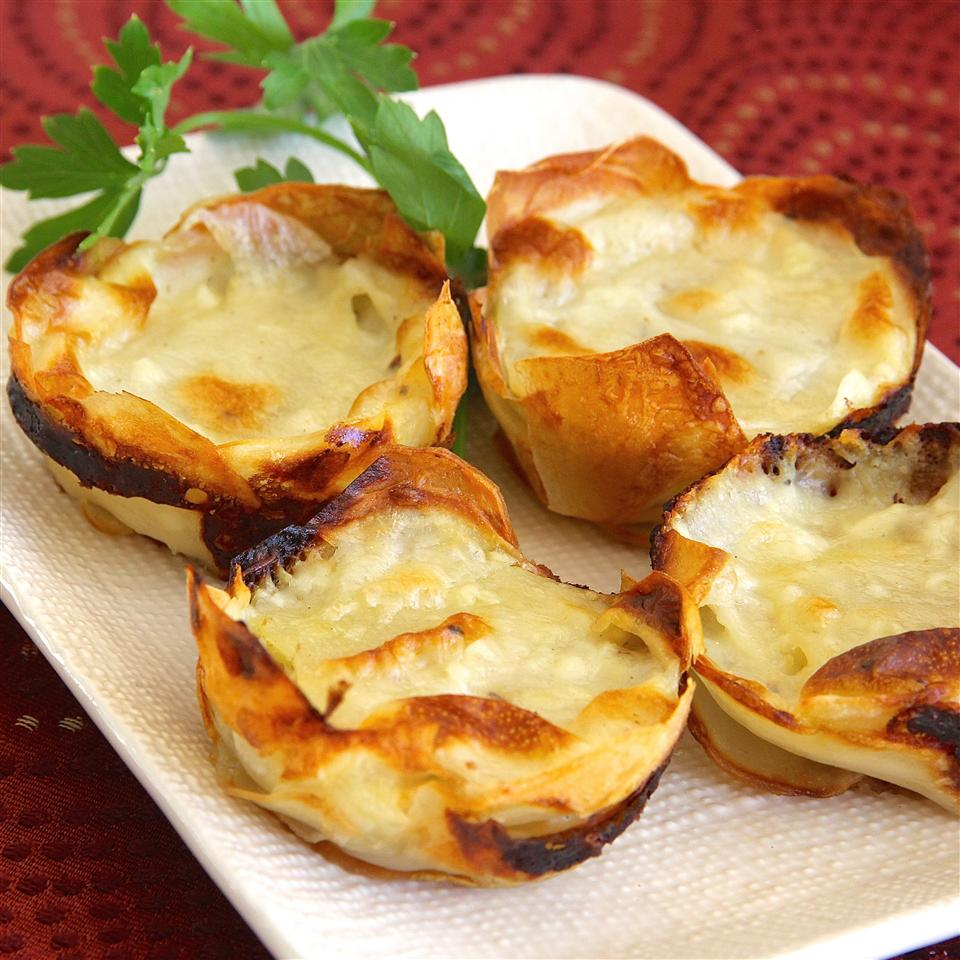 Muffin Tin Potatoes Gratin on a white dish with parsley garnish