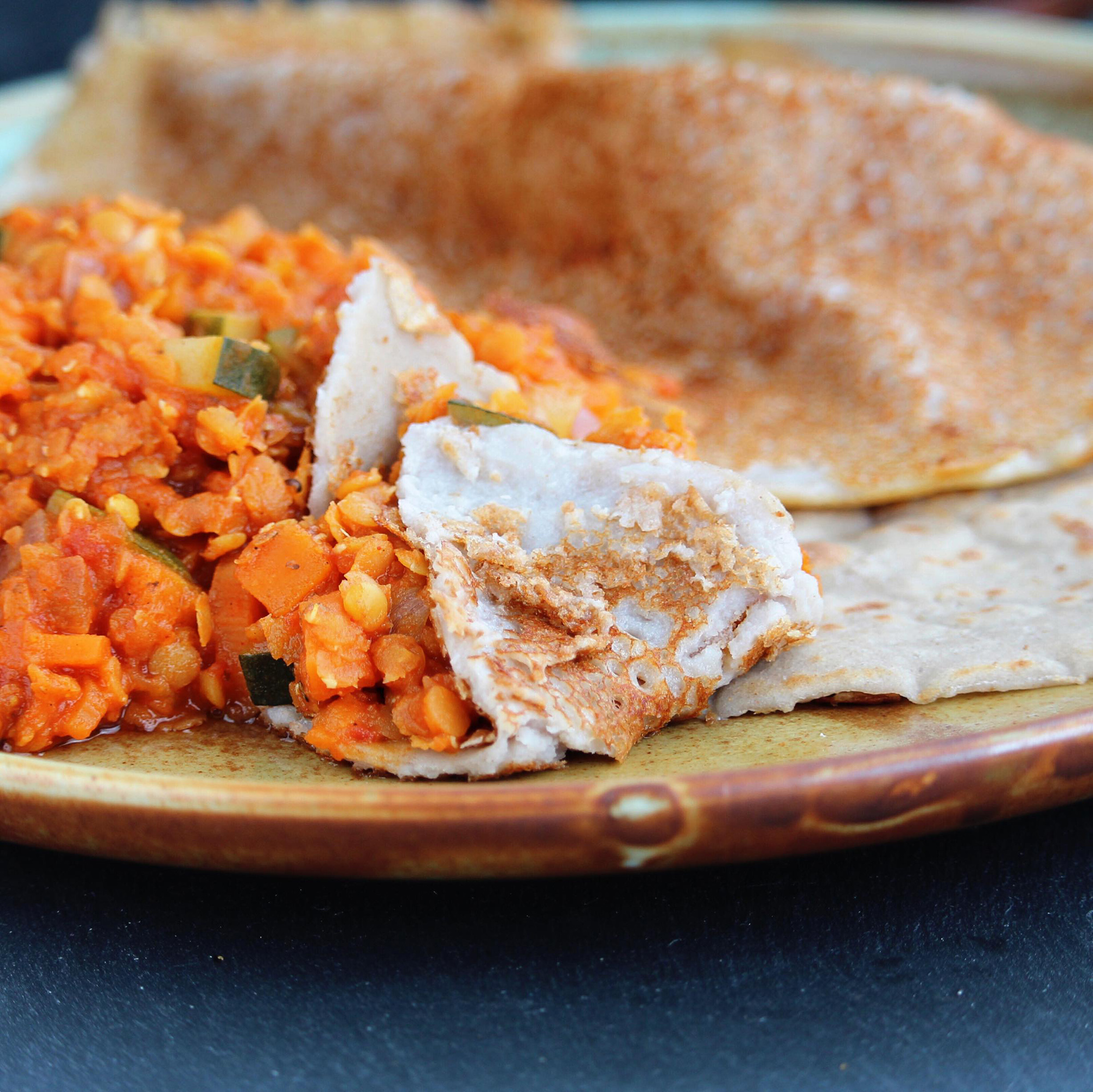 Injera with spiced red lentils