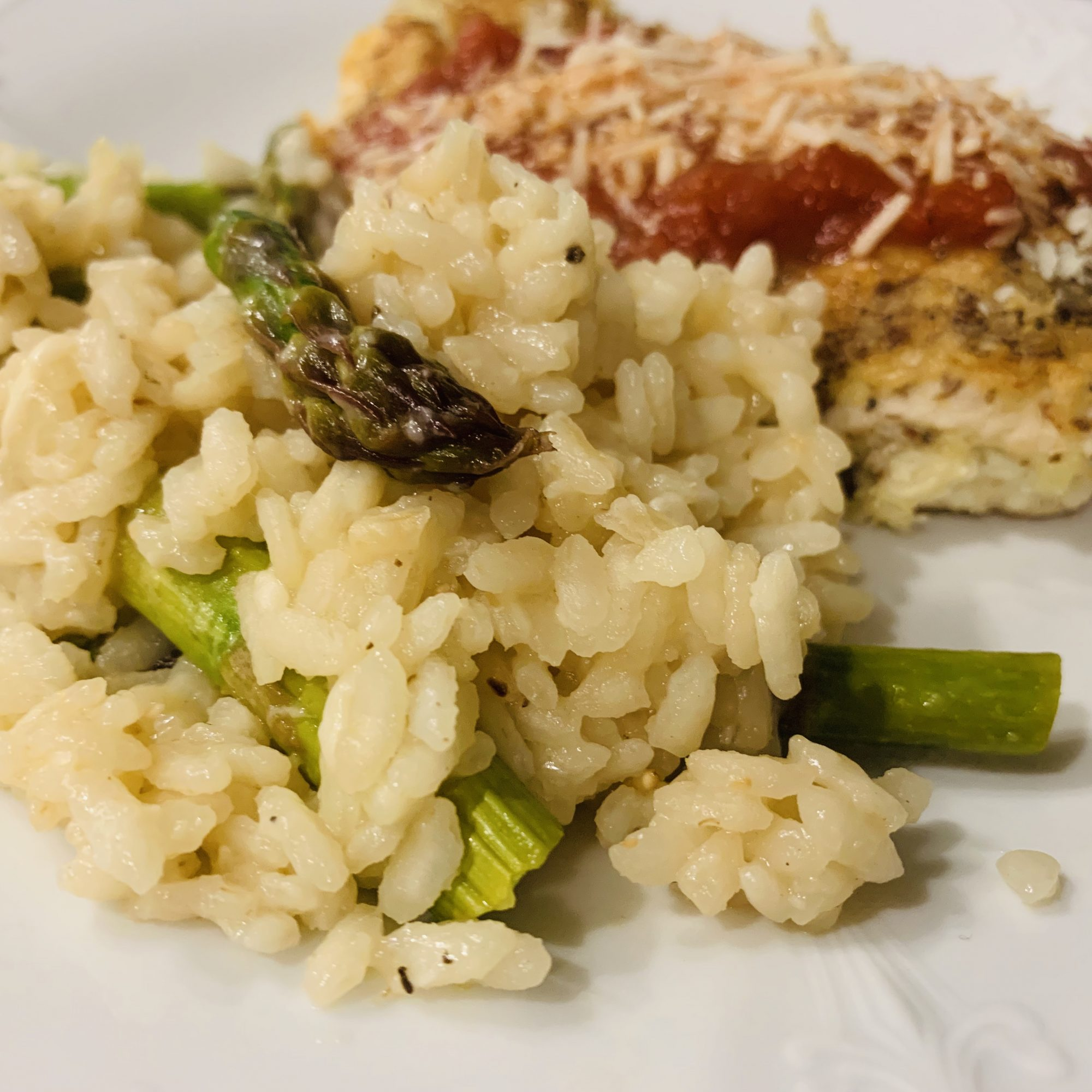 risotto with asparagus on a white plate