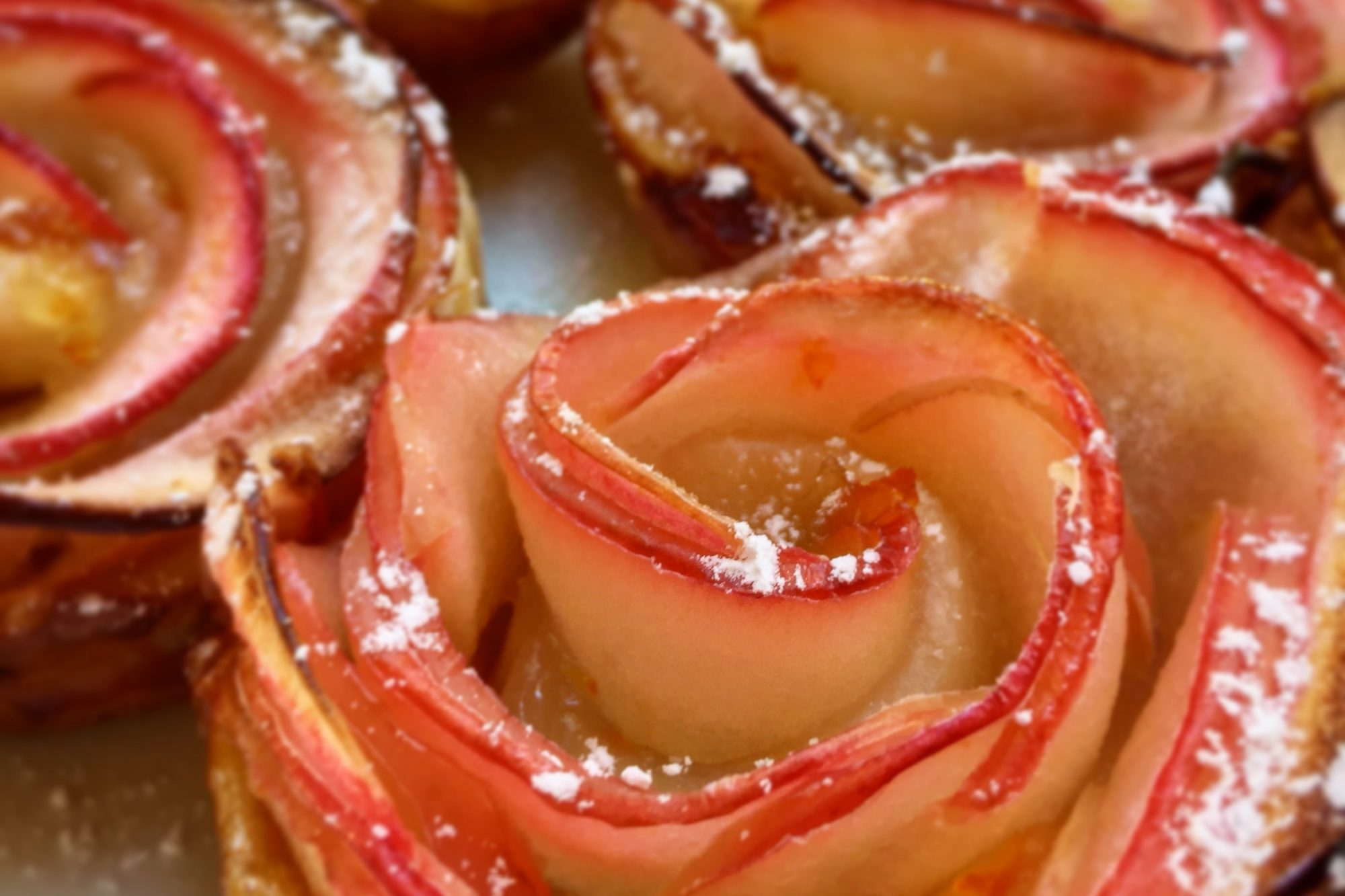 Baked Apple Roses with powdered sugar on top