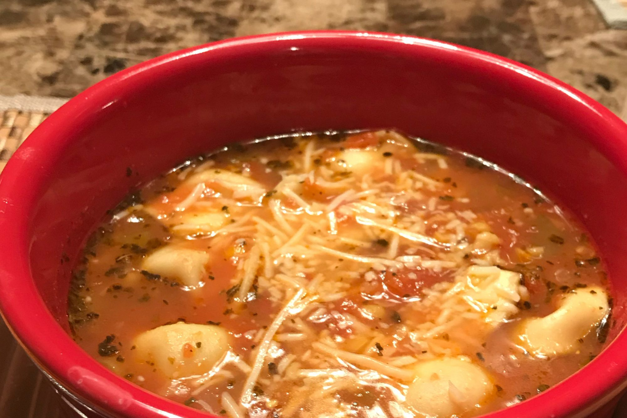 Tortellini Soup in a red bowl