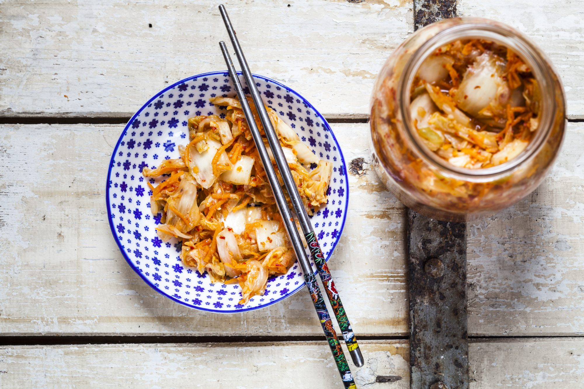 Homemade korean kimchi with chinese cabbage, scallions and carrots