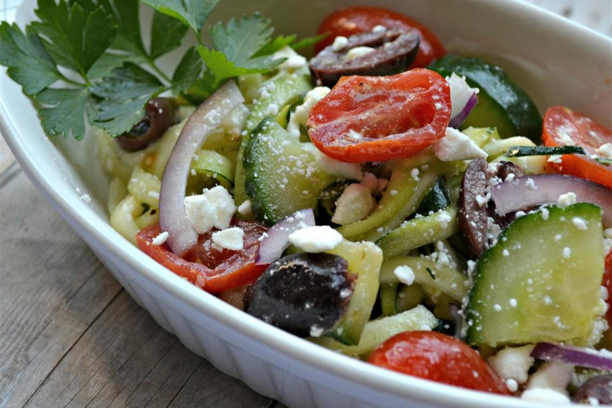Greek Zoodle Salad in white bowl