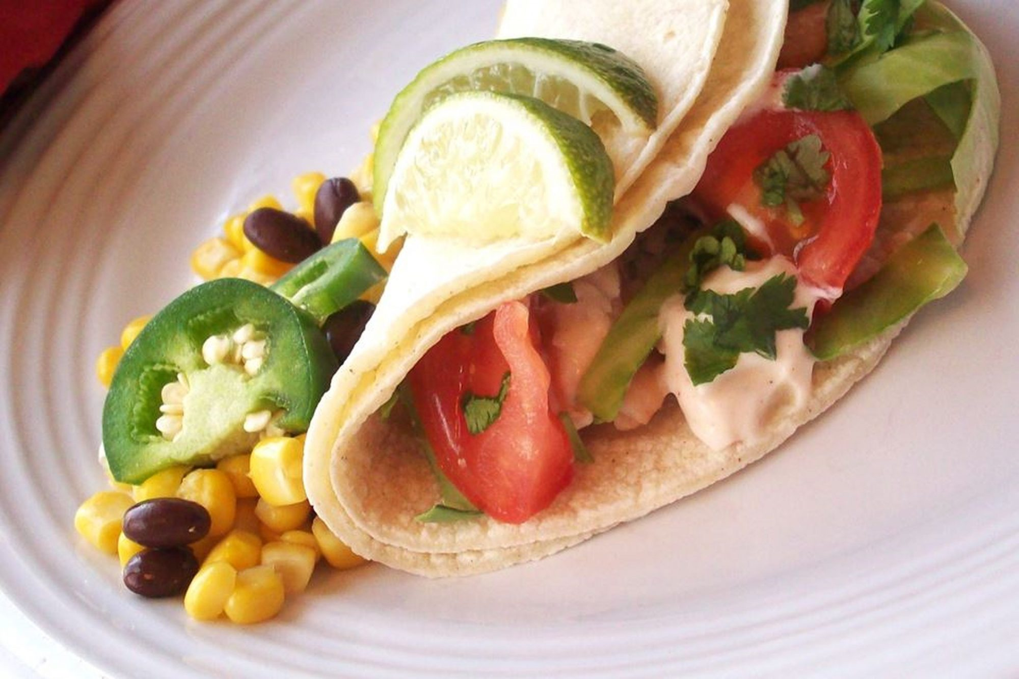 Grilled Fish Tacos with Chipotle-Lime Dressing on white plate