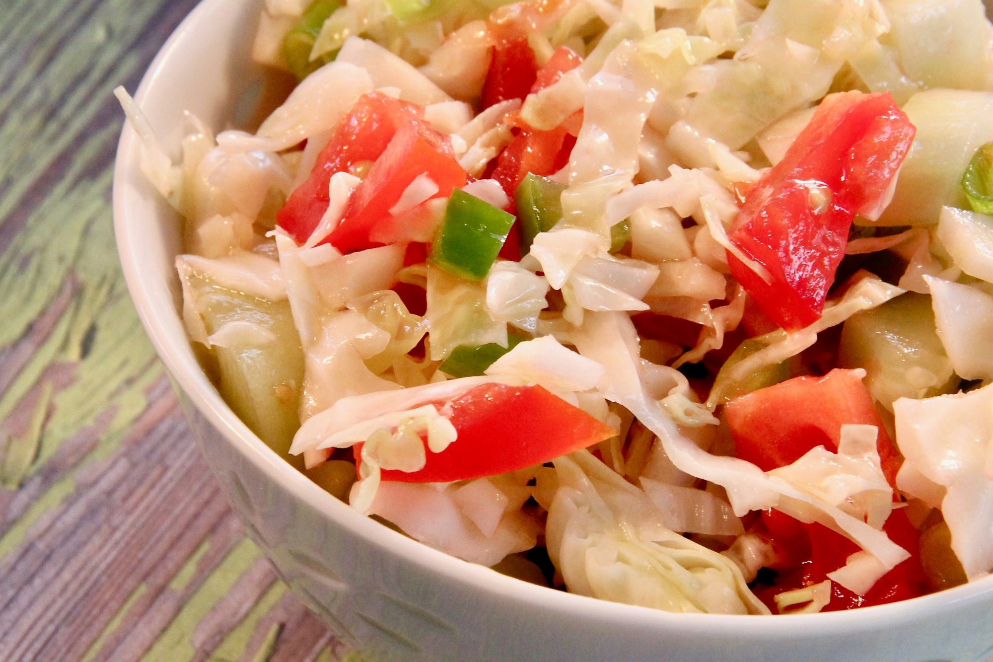 Picnic Marinated Summer Slaw in white bowl on wooden table