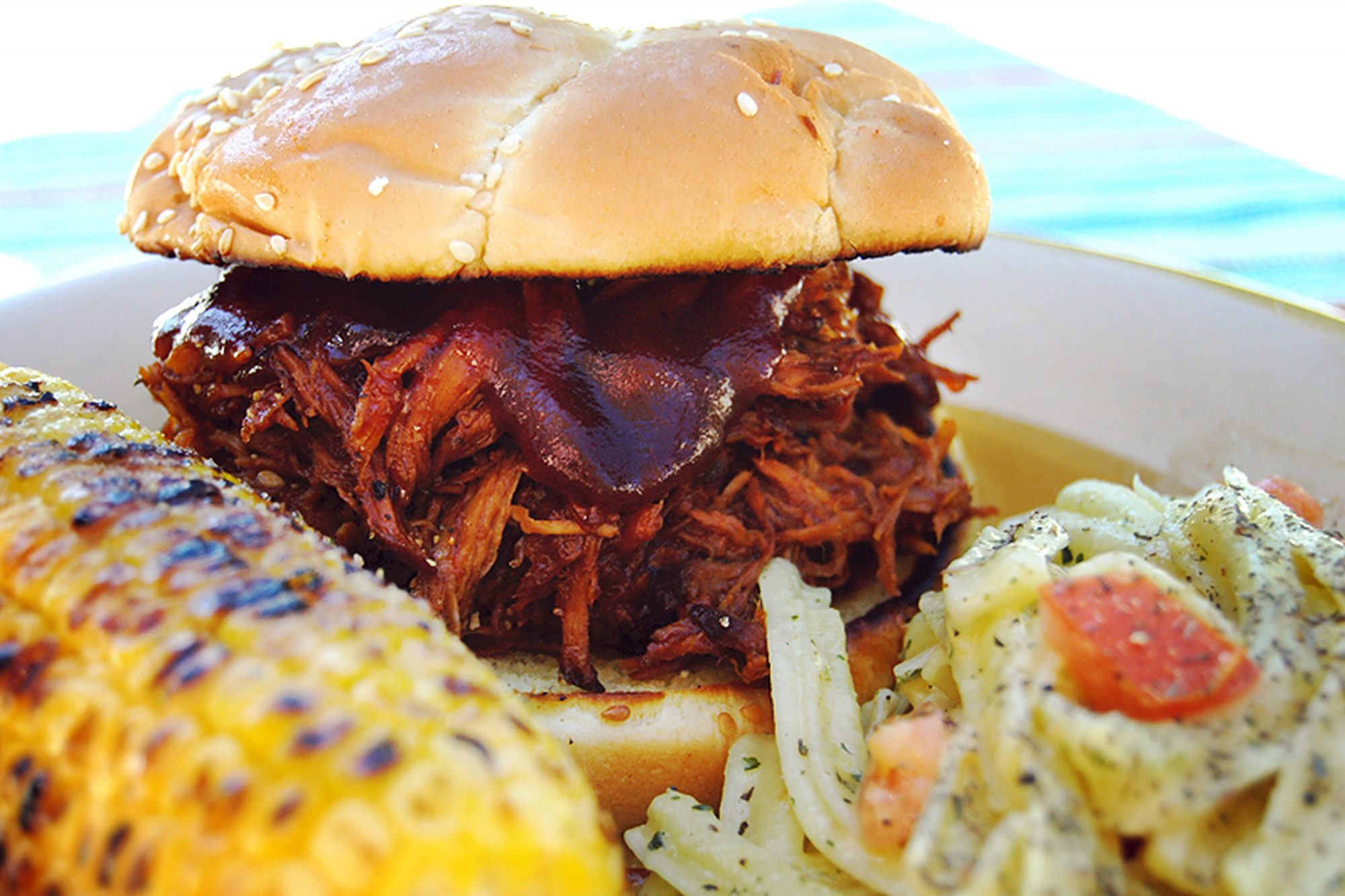 Slow Cooker Texas Pulled Pork with buns, cole slaw, corn on the cob