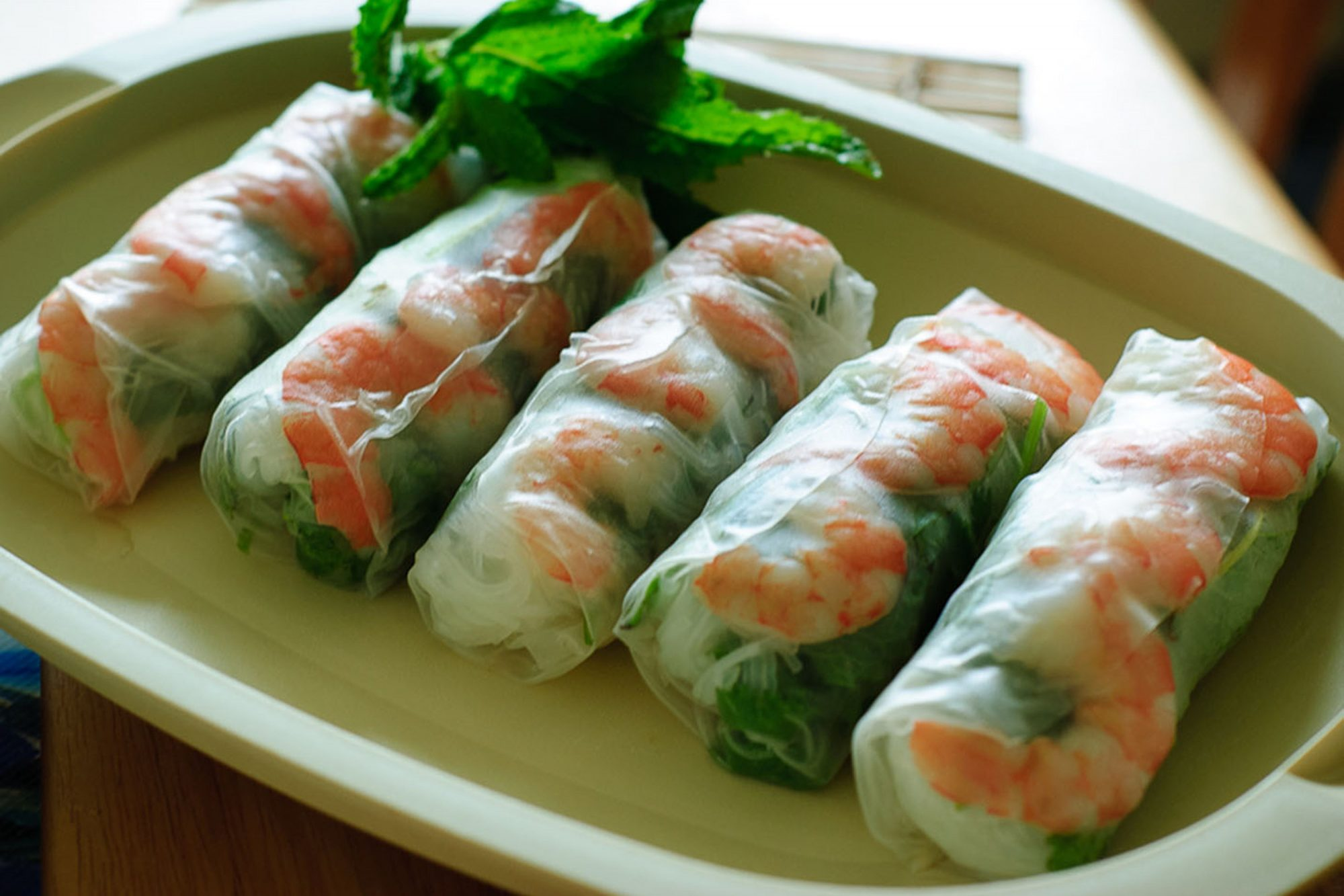 Vietnamese Fresh Spring Rolls on green plate