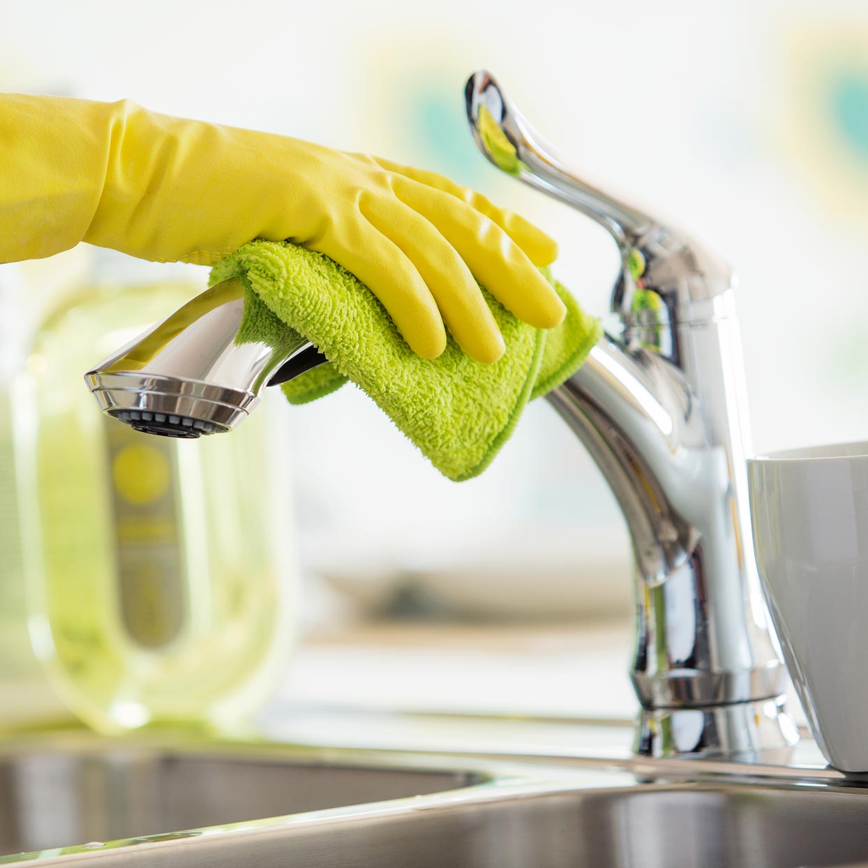 cleaning sink with rag and yellow gloves