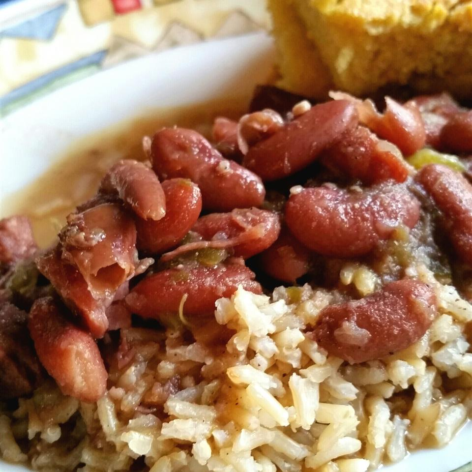 Authentic New Orleans Red Beans and Rice in a white bowl with cornbread