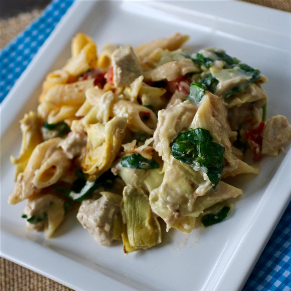 Fans of classic spinach artichoke dip will absolutely love this creamy pasta, which is easier than it looks thanks to jarred artichokes, jarred Alfredo sauce, and frozen spinach.