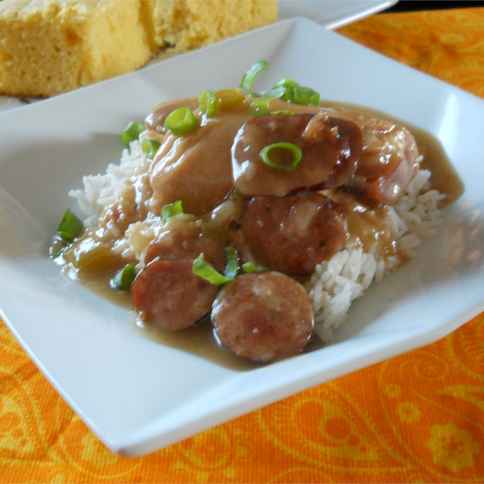 """With chicken thighs, andouille sausage, and rice, this substantial dish can feed a (large) family. """"And of course,"""" recipe creator Laura Poche says, """"what Cajun dish would be complete without the roux?"""""""