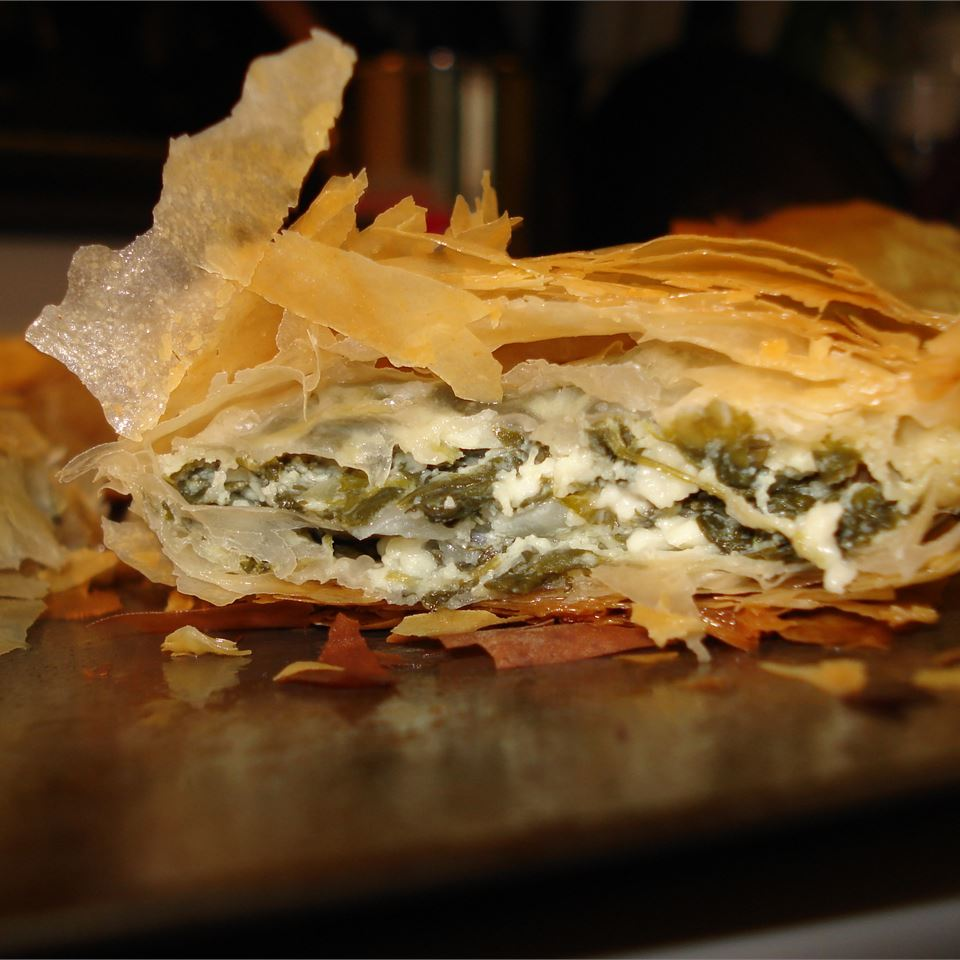 flaky Spanakopita with layers of cheese, spinach, and phyllo