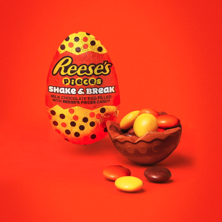 Reese's Pieces Eggs cracked open to show the Pieces inside the chocolate shell