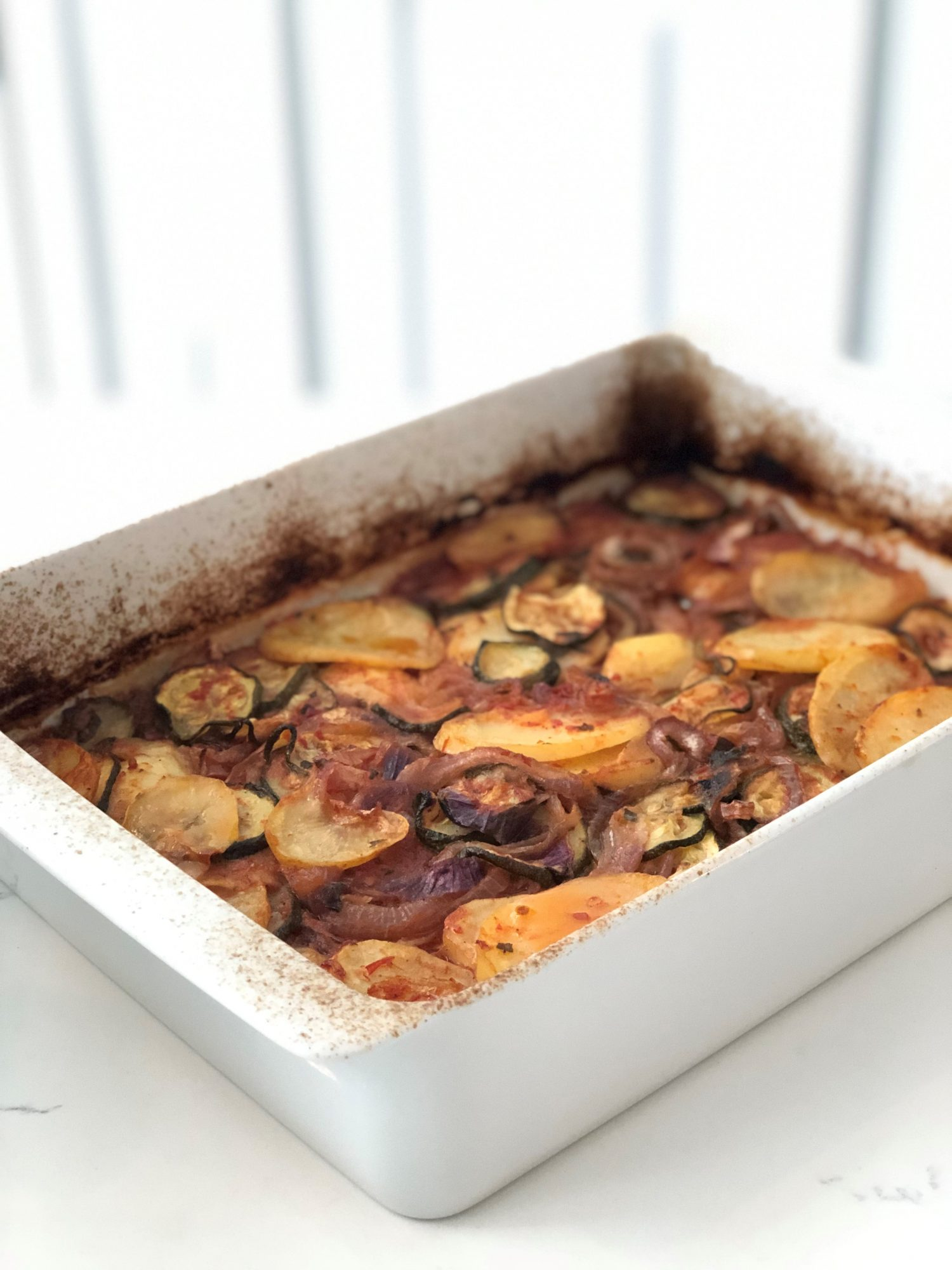 Briam, or baked zucchini and potatoes, is a vegan main course.
