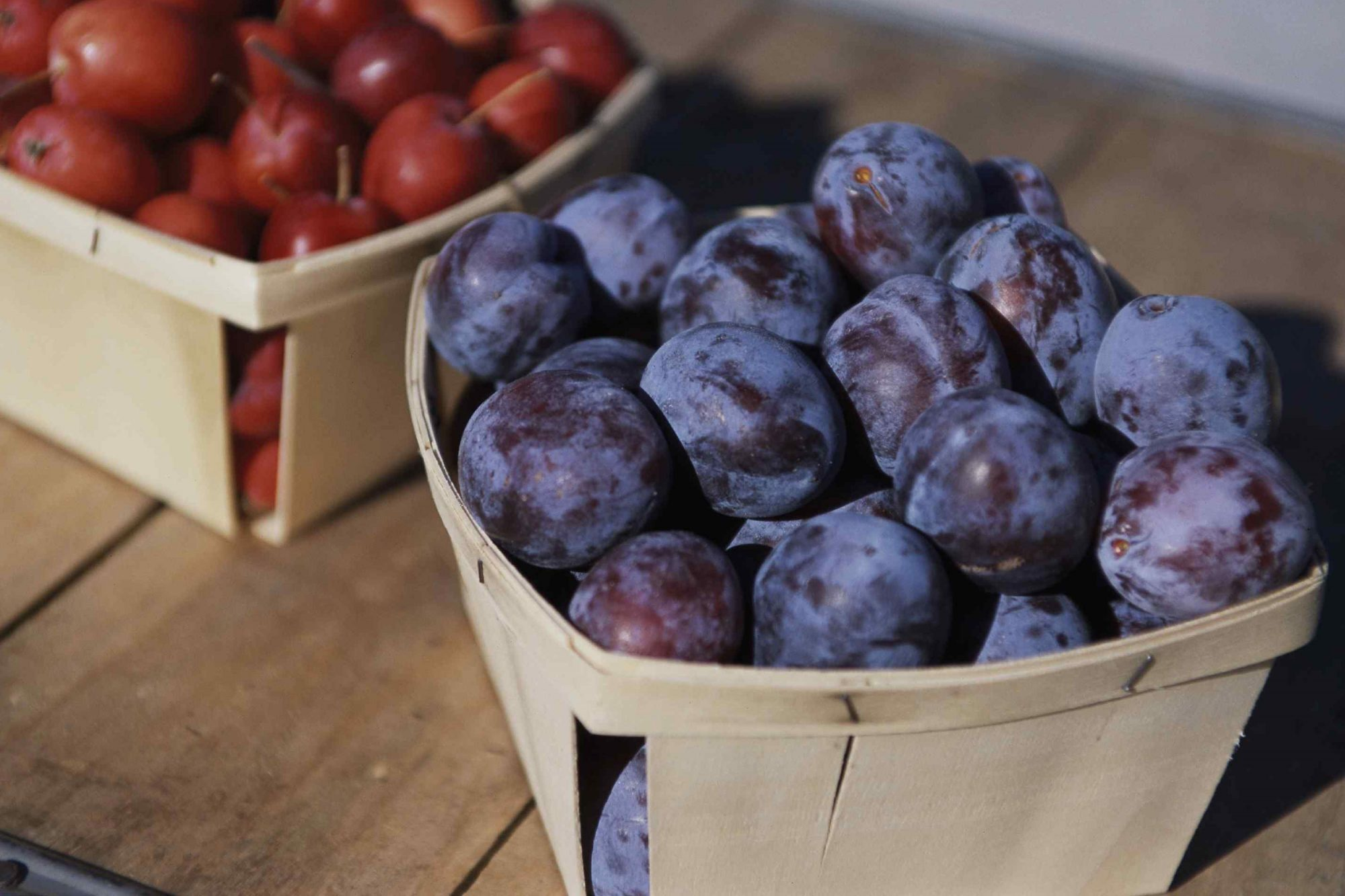 Plums in wood crates