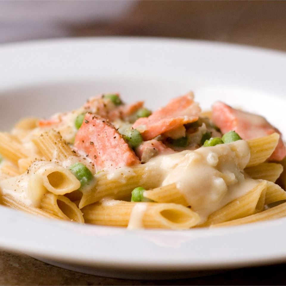 salmon pasta in a creamy sauce on a white plate