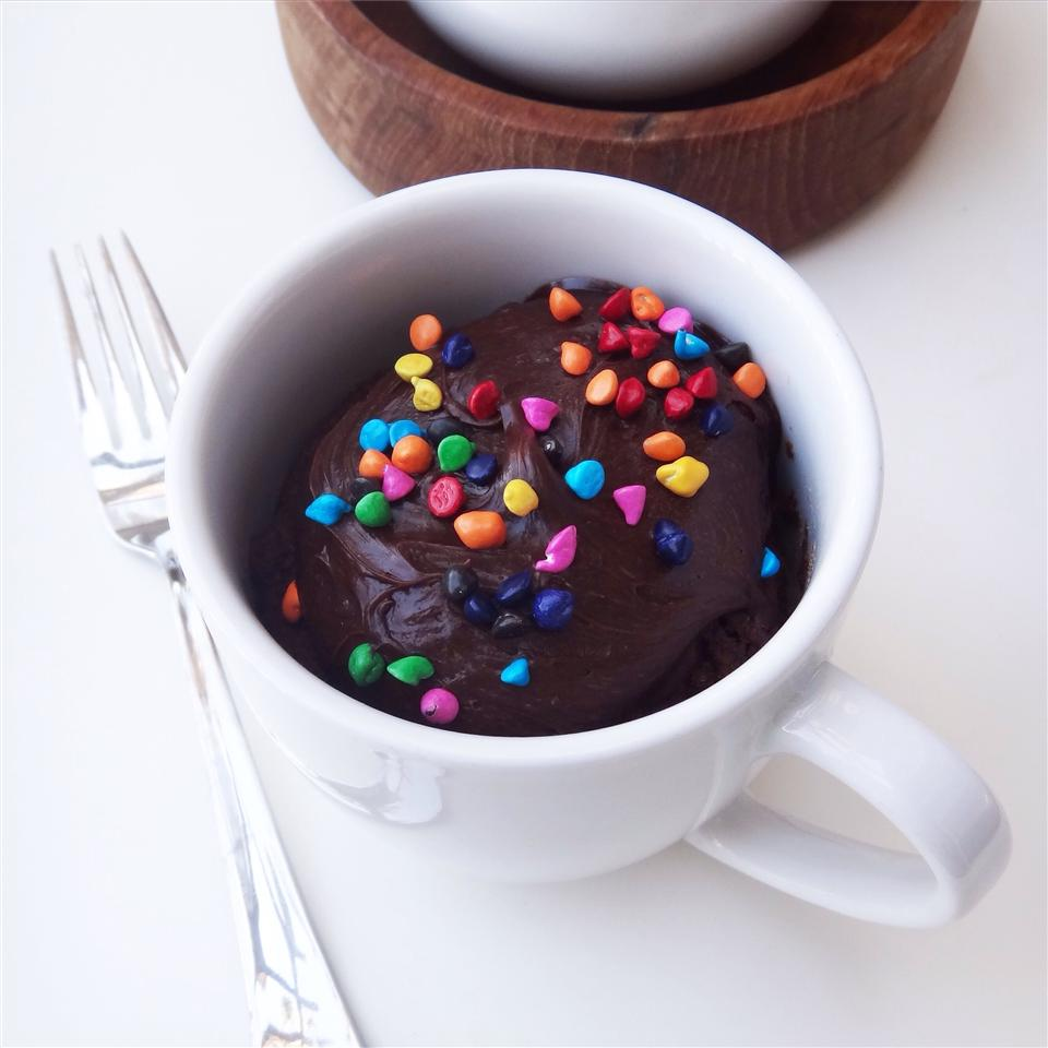 chocolate nutella mug cake with colorful candy on top