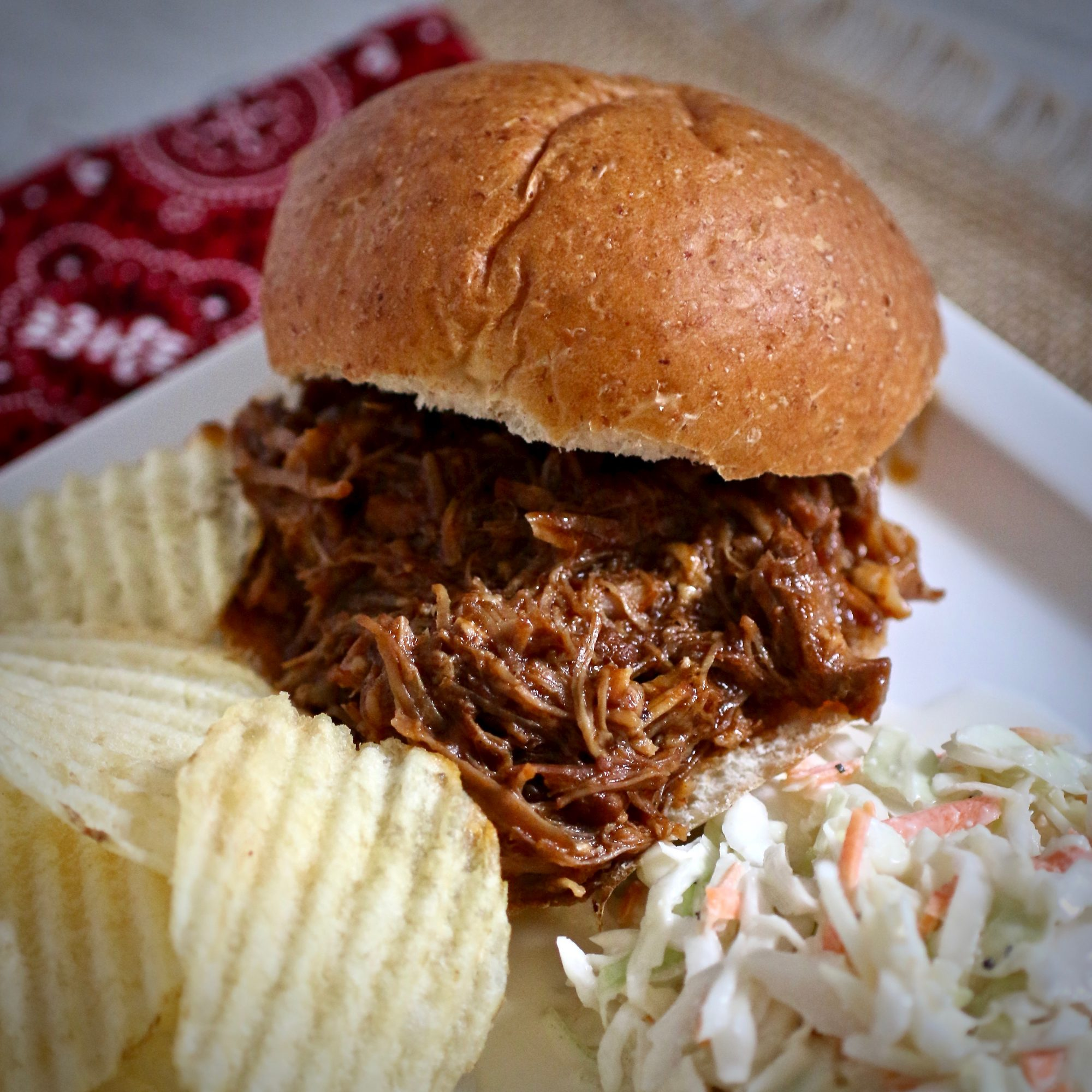 Instant Pot® Pulled Pork Sandwich with chips and coleslaw
