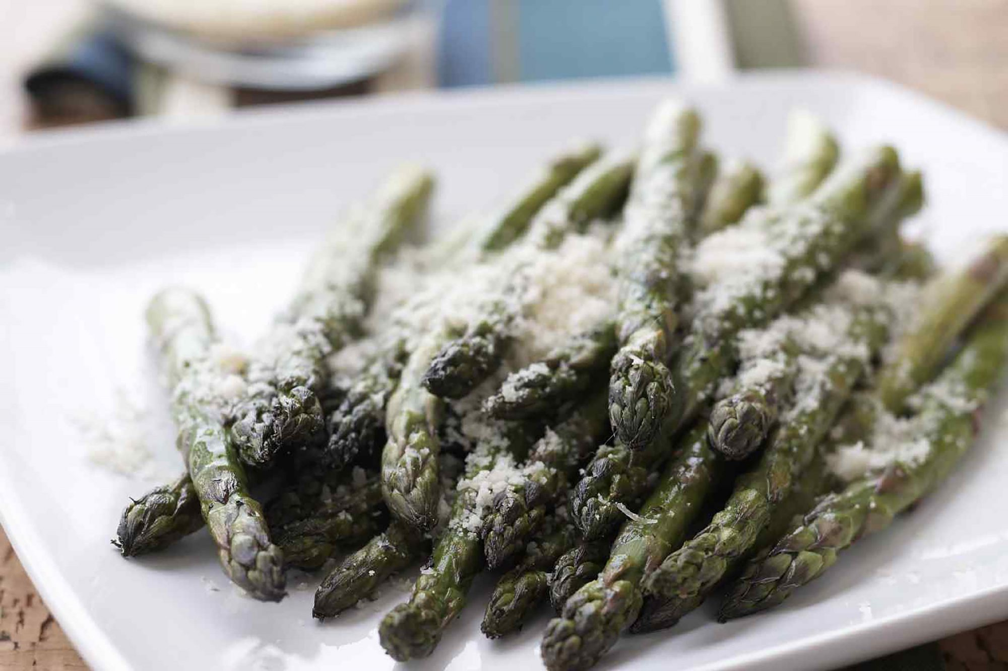 Asparagus with parmesan on white plate