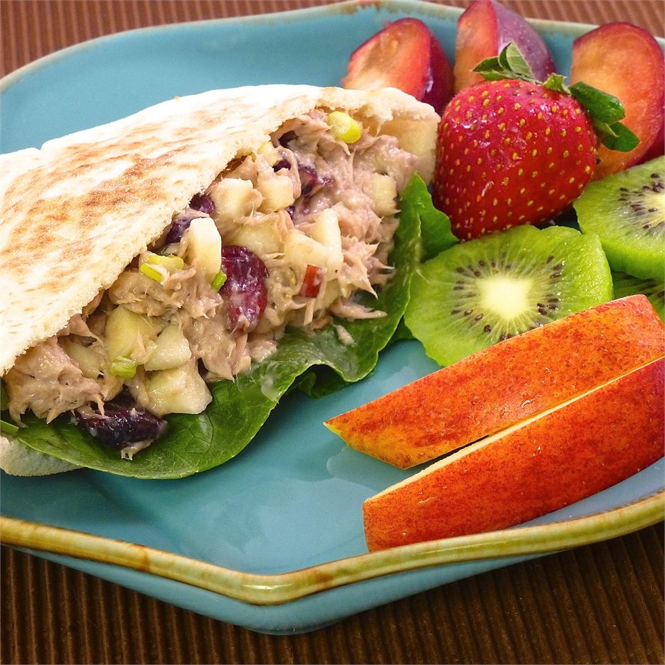 Amazingly Good and Healthy Tuna Salad served with fruit on a blue plate