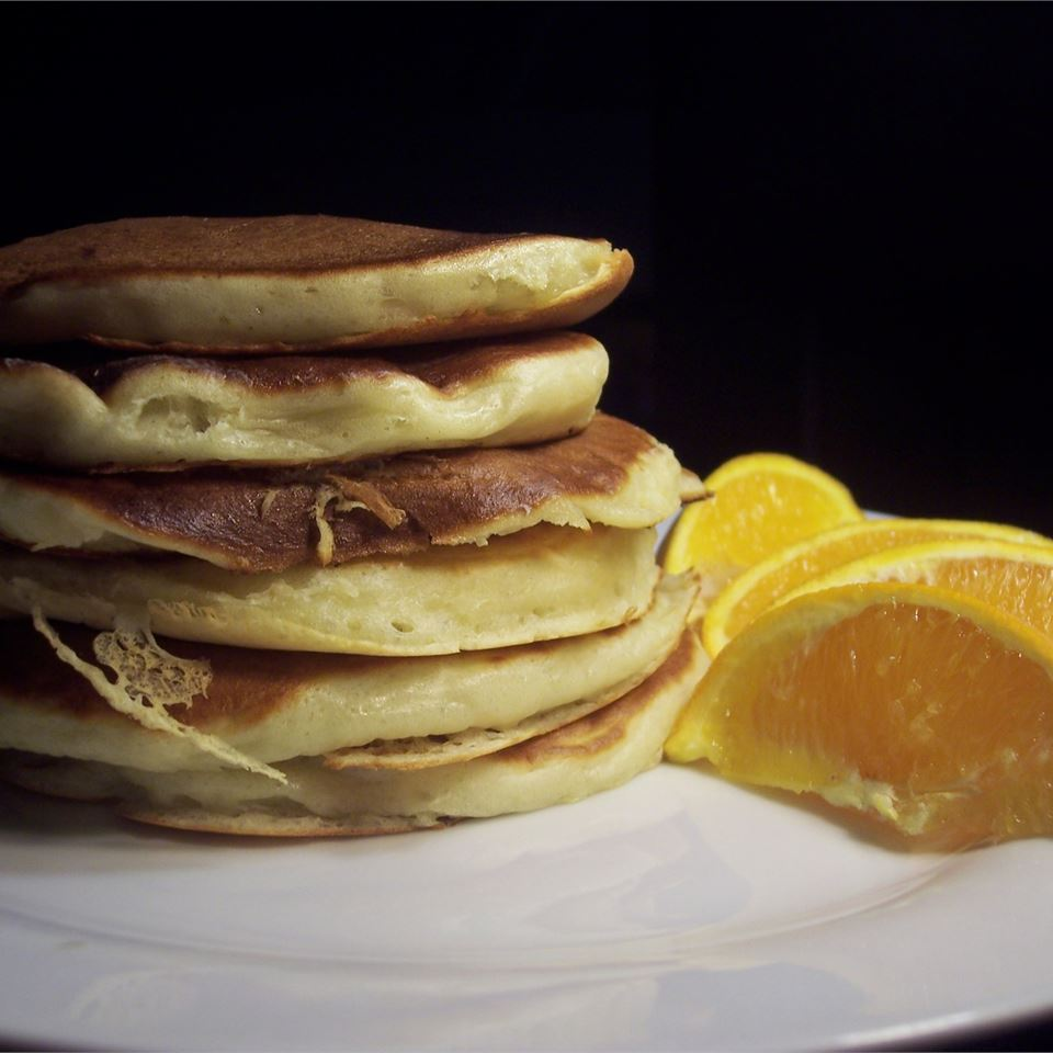 Buttermilk Pancakes stacked next to orange slices
