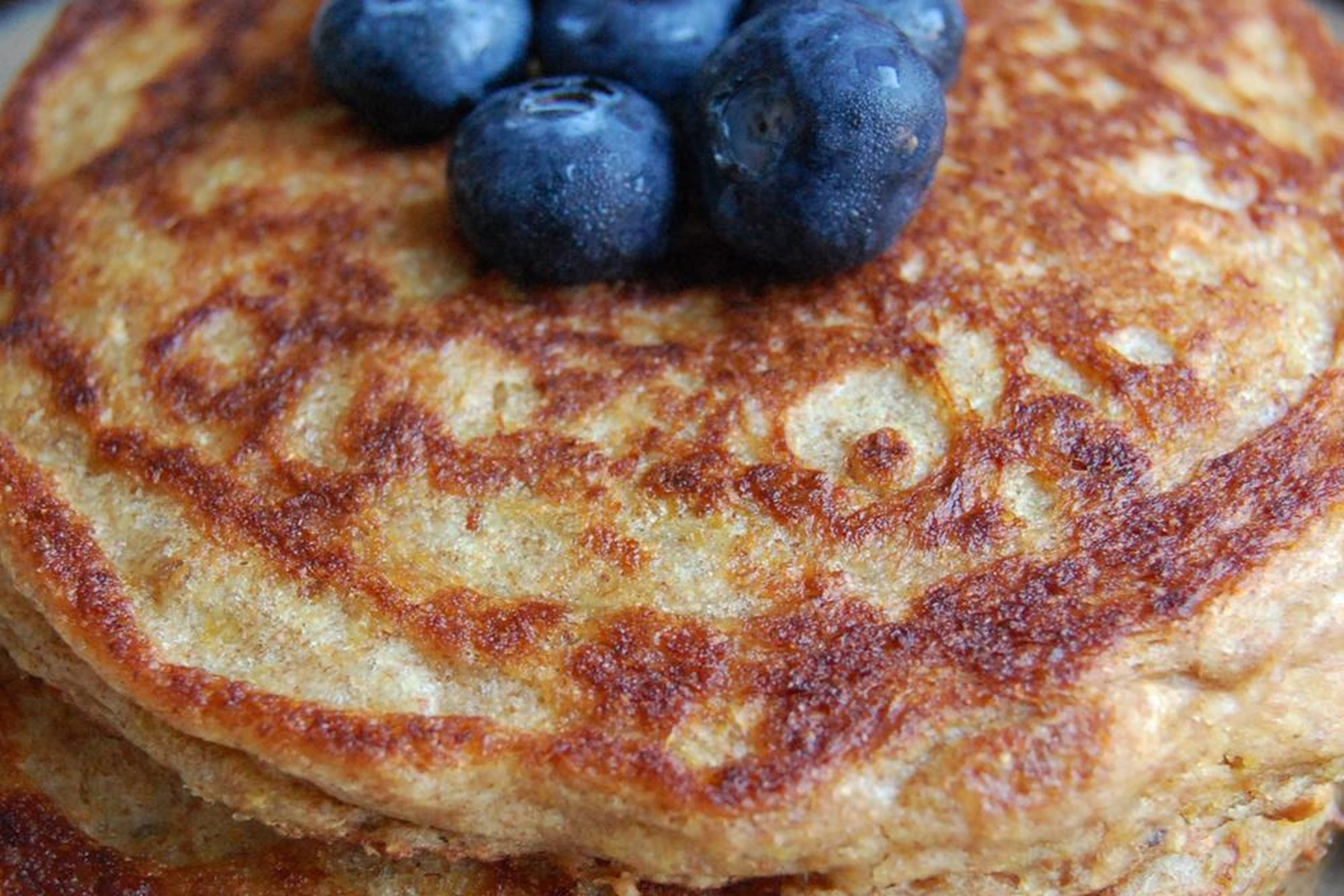 Wheat Germ Whole-Wheat Buttermilk Pancakes with blueberries on top