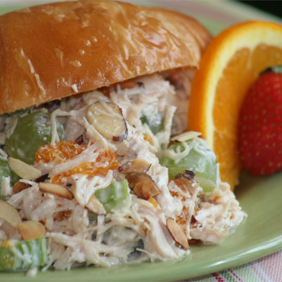 Gourmet Chicken Salad in a bun served with fruit
