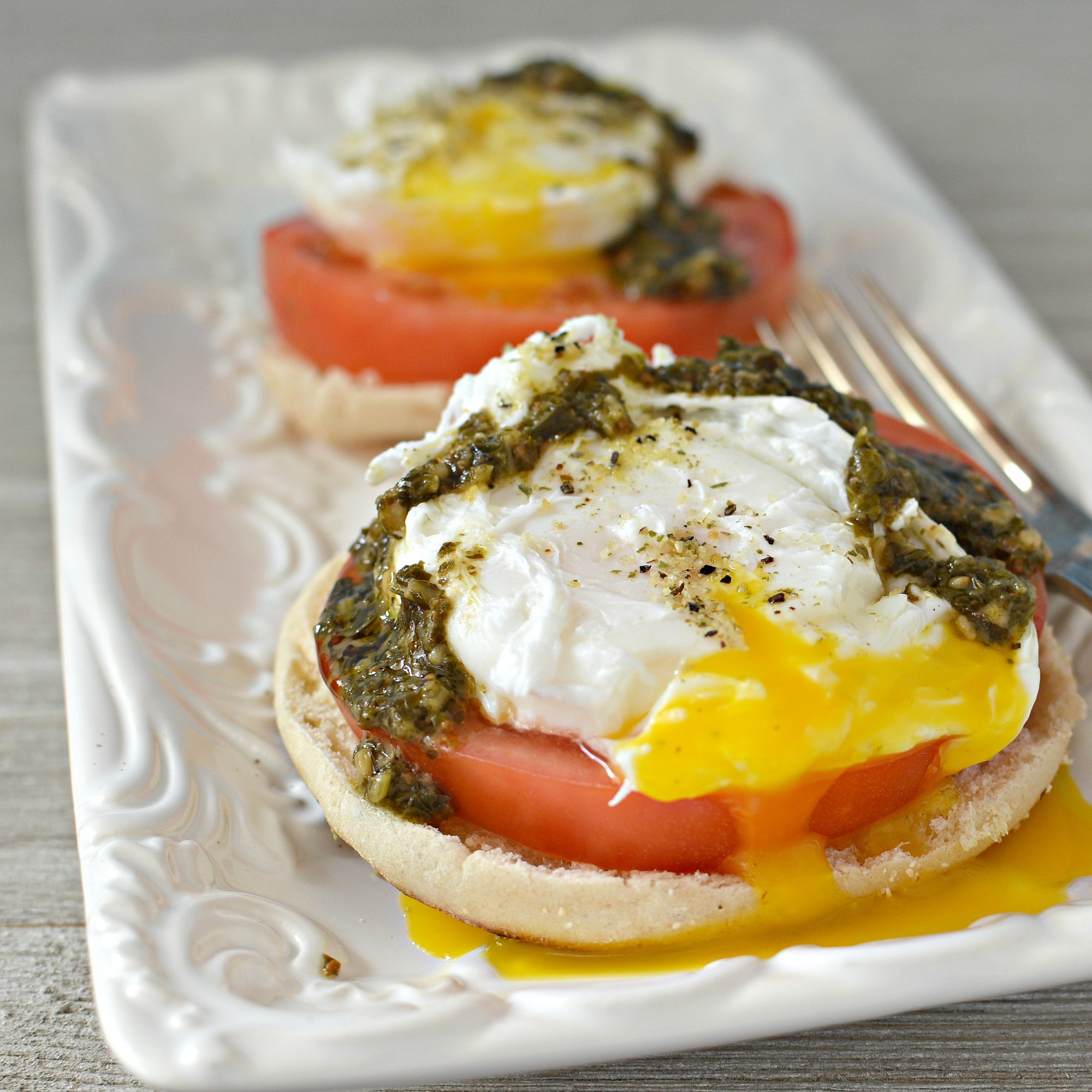 Poached Eggs Caprese on a white plate