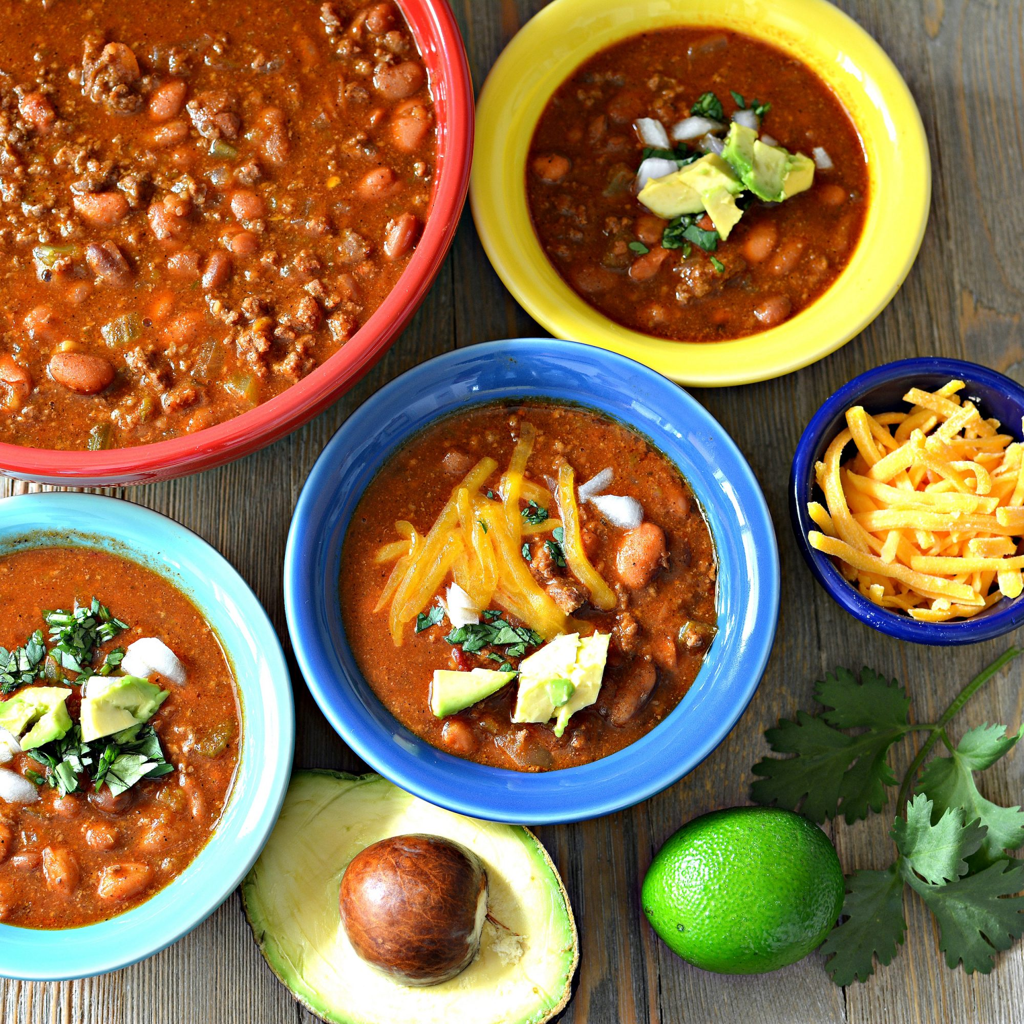 Instant Pot® Quick and Easy Outlaw Chili Beans in colorful bowls