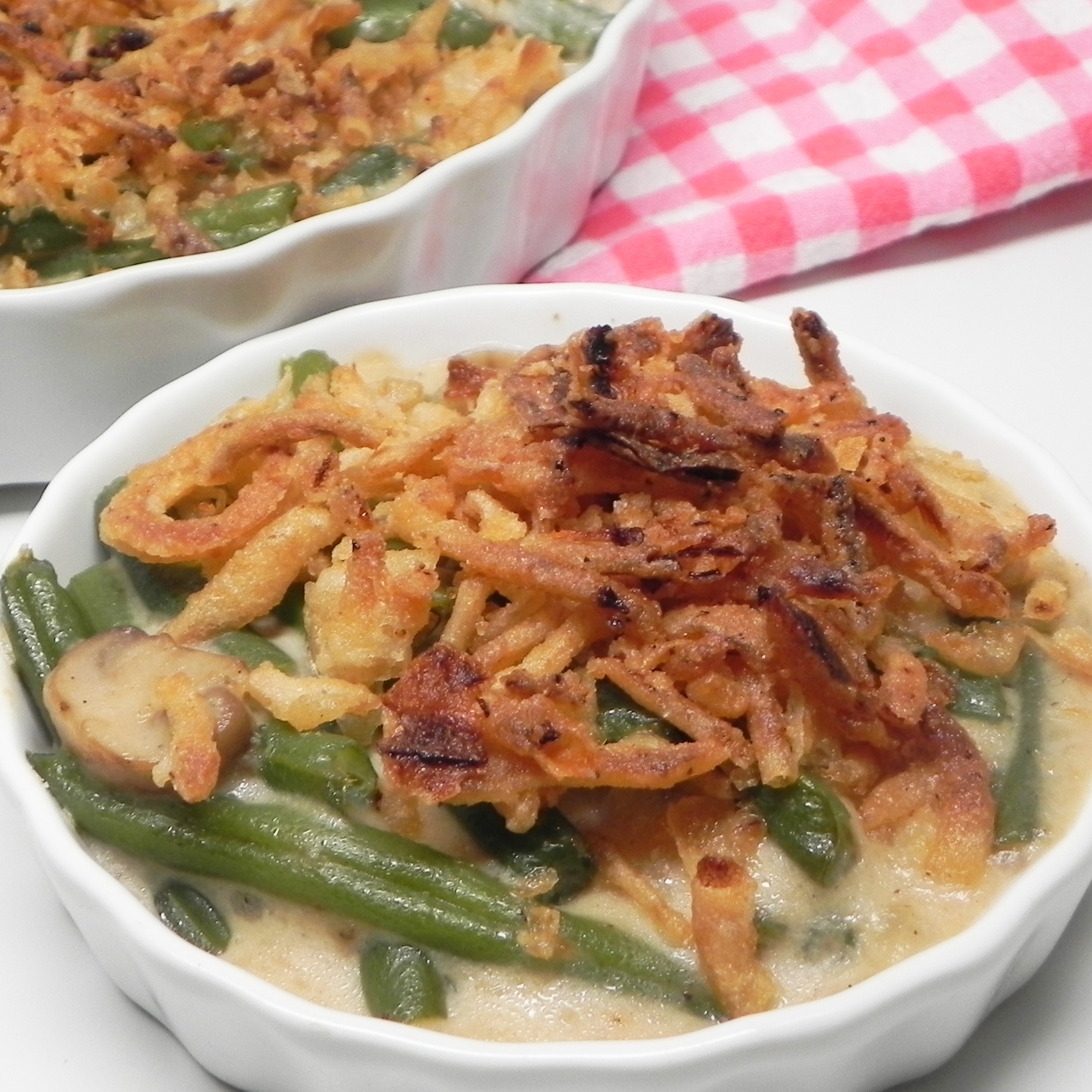 serving of green bean casserole in white bowl