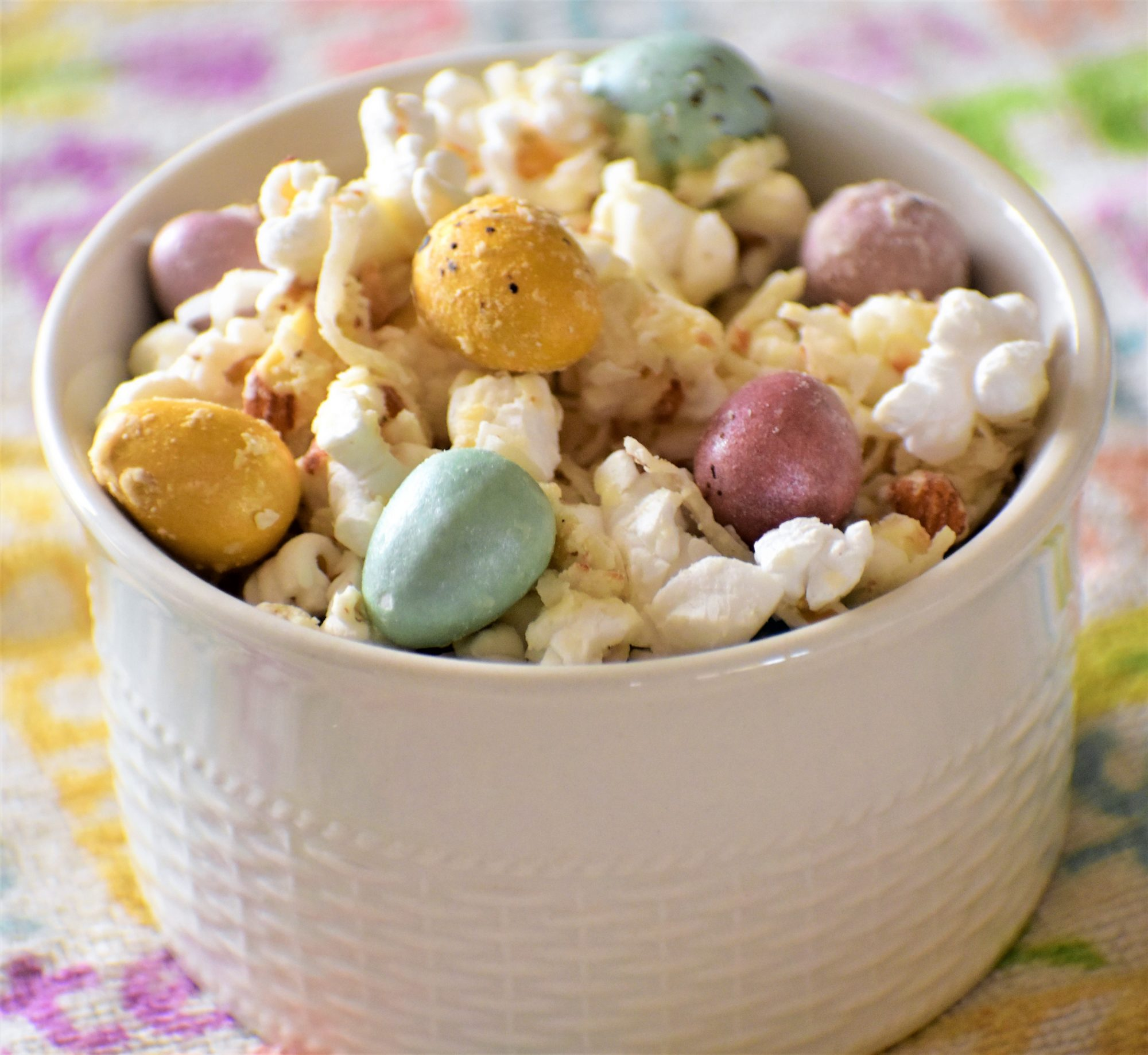"""This popcorn is an easy and festive way to enjoy Easter candy!,"" says Kim. ""You can use any kind of candy, nuts, or 'mix-ins' that you like! And make sure to adjust the salt at the end, it really helps to balance out the sweetness!""                                   More: See our entire collection of Easter desserts."