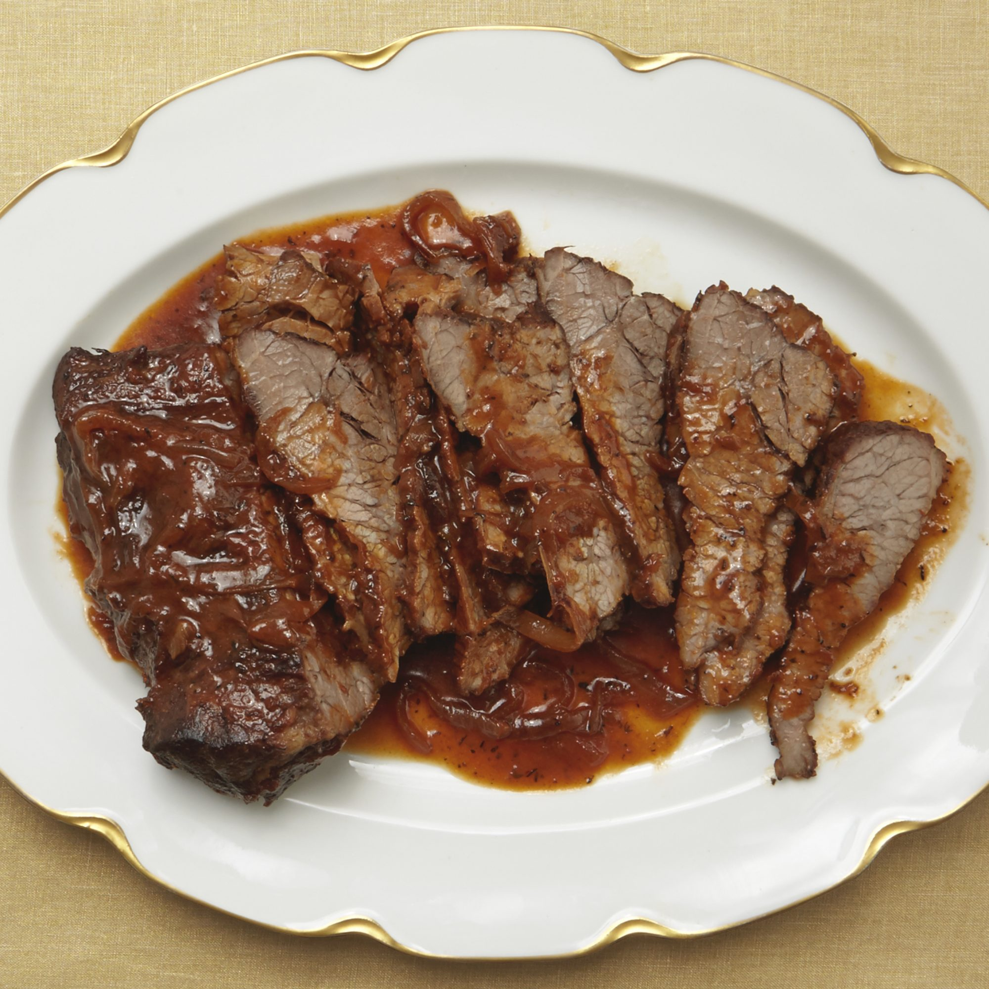 beef brisket on a white plate