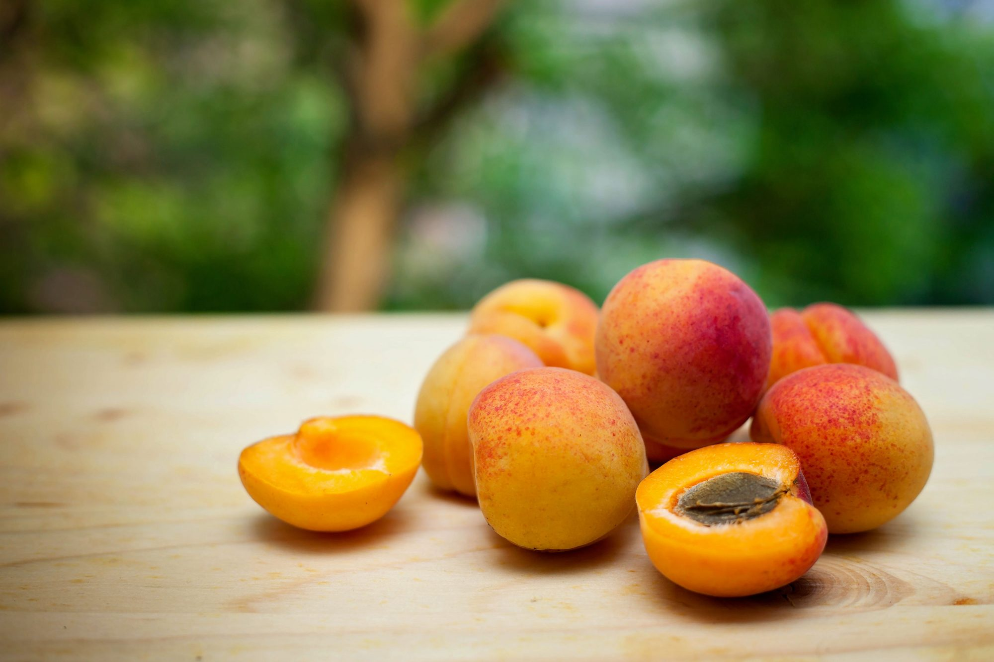 Apricots on wooden table